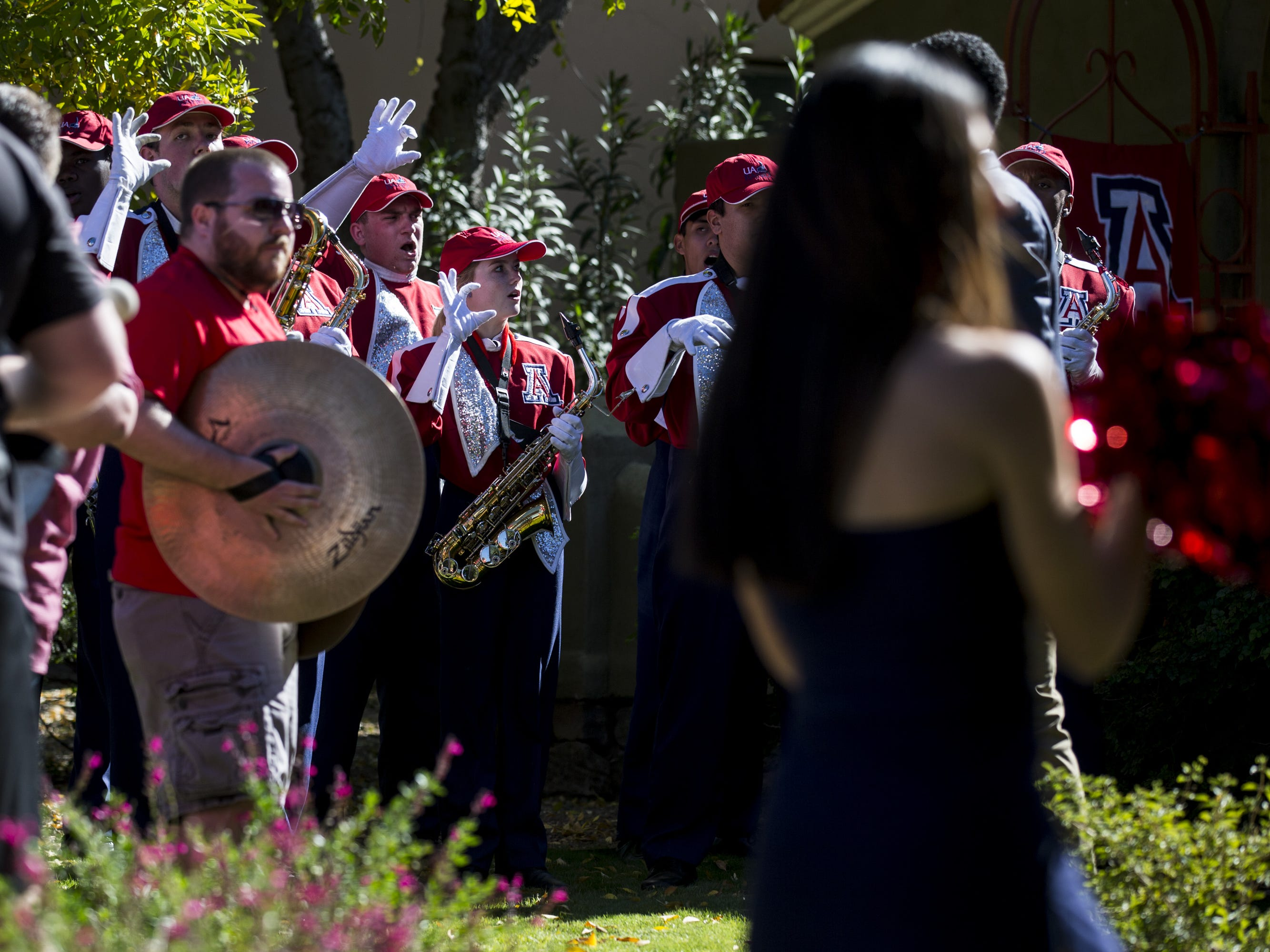 The Arizona marching band performs in a front yard before the Territorial Cup football game on Saturday, Nov. 24, 2018, at Arizona Stadium in Tucson, Ariz.