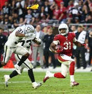 Arizona Cardinals running back David Johnson runs for an apaprent touchdown against the Oakland Raiders on Nov. 18, 2018, but the TD has called back due to holding.