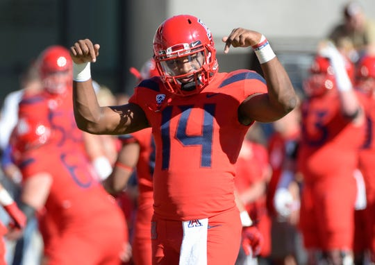 Nov 24, 2018; Tucson, AZ, USA; Arizona Wildcats quarterback Khalil Tate (14) signals during warm ups before playing the Arizona State Sun Devils at Arizona Stadium. Mandatory Credit: Casey Sapio-USA TODAY Sports