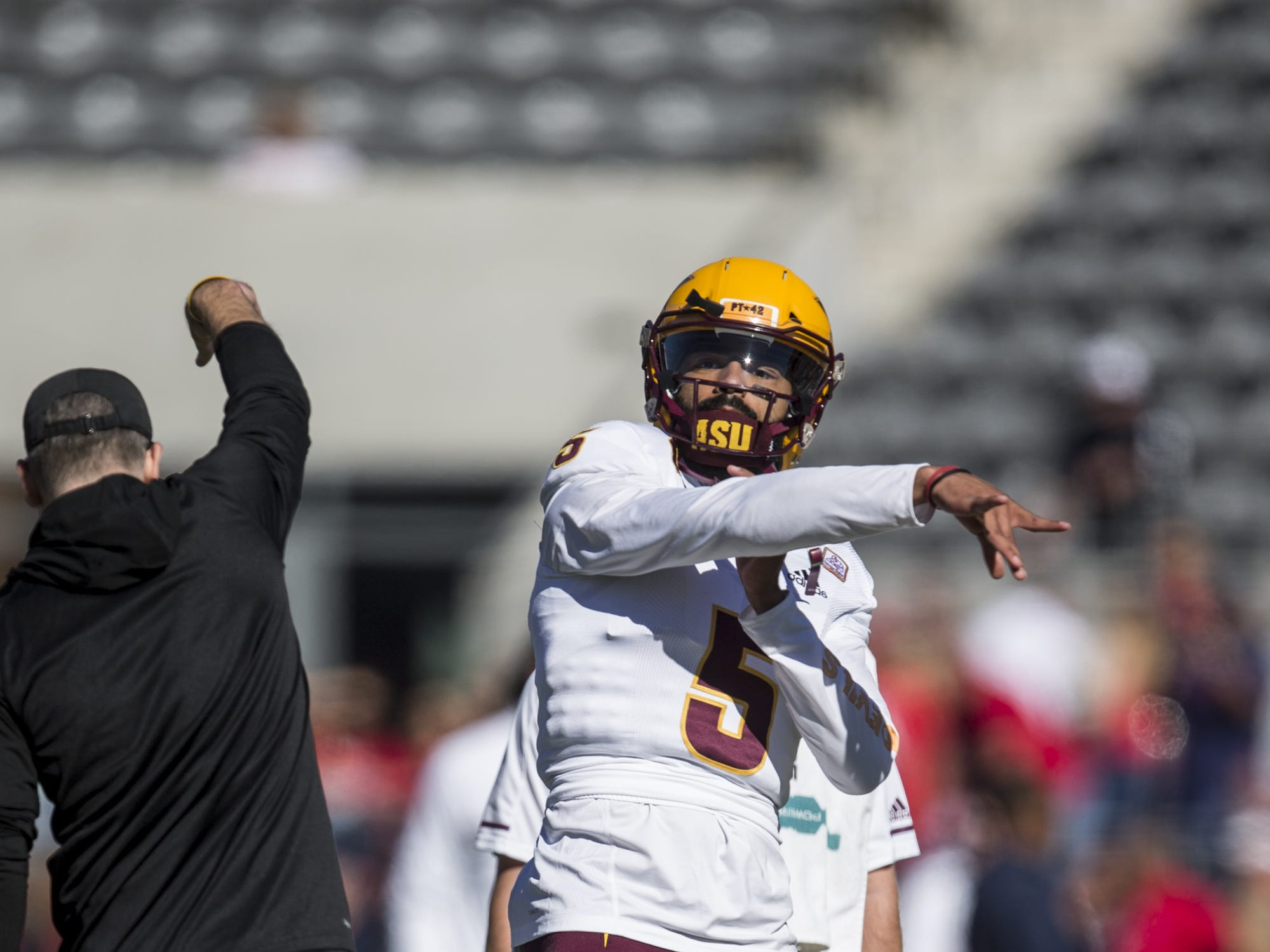 Arizona State's Manny Wilkins warms up before the Territorial Cup football game on Saturday, Nov. 24, 2018, at Arizona Stadium in Tucson, Ariz.