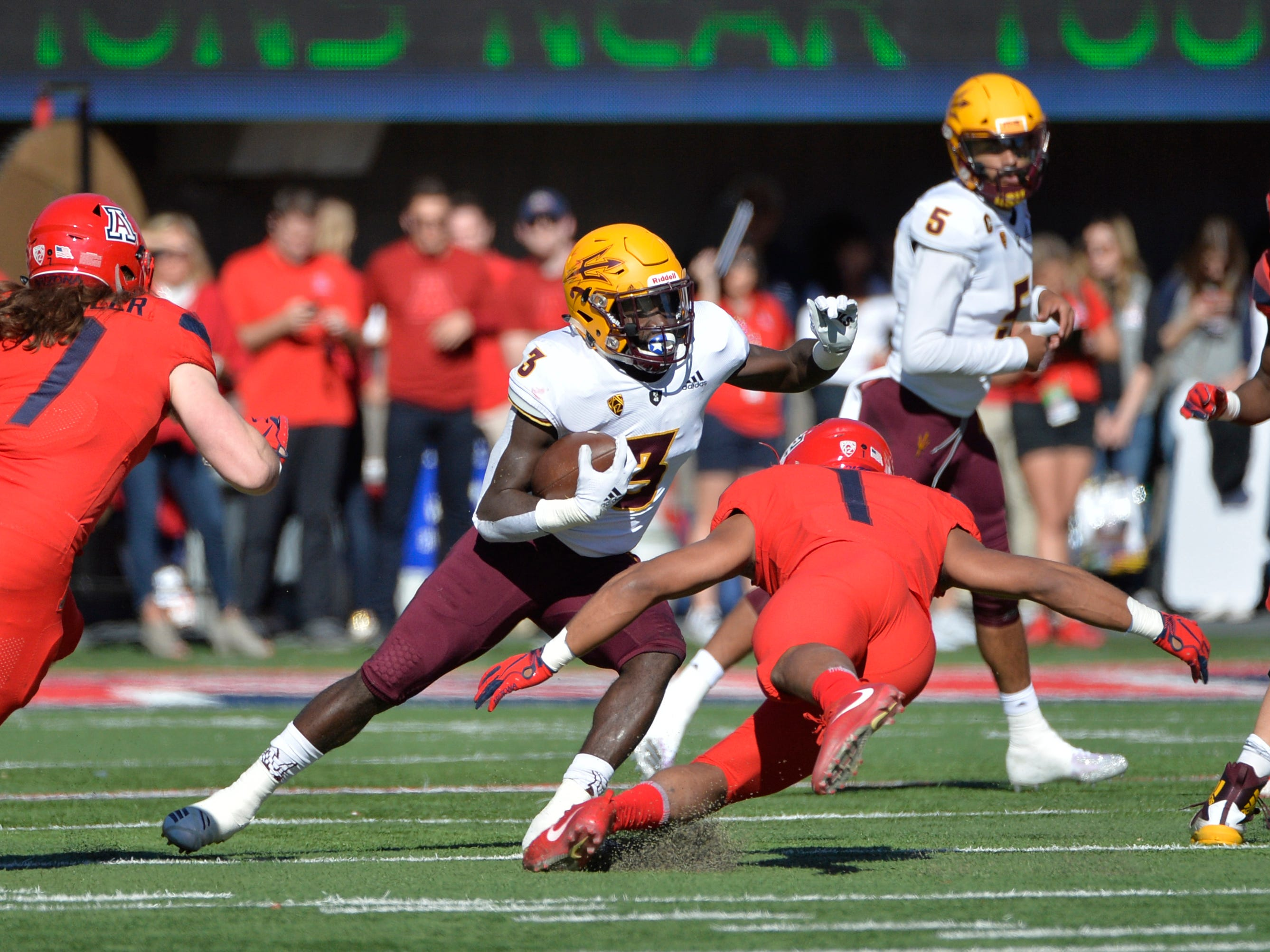 Nov 24, 2018; Tucson, AZ, USA; Arizona State Sun Devils running back Eno Benjamin (3) runs the ball against Arizona Wildcats linebacker Tony Fields II (1) at Arizona Stadium. Mandatory Credit: Casey Sapio-USA TODAY Sports