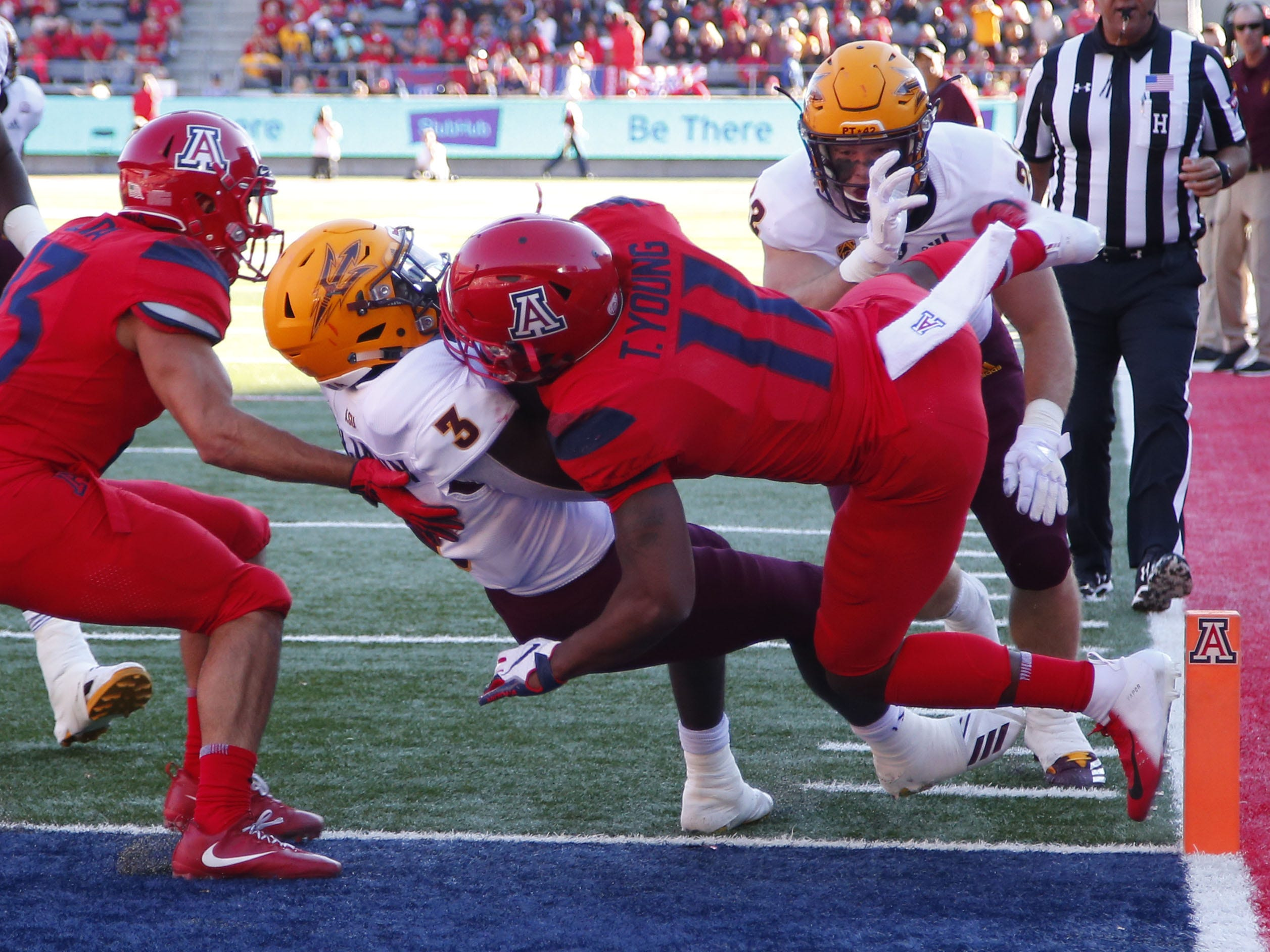 Arizona Wildcats safety Troy Young (11) can not stop Arizona State Sun Devils running back Eno Benjamin (3) from scoring a touchdown during the Territorial Cup football game at Arizona Stadium in Tucson on November 24.