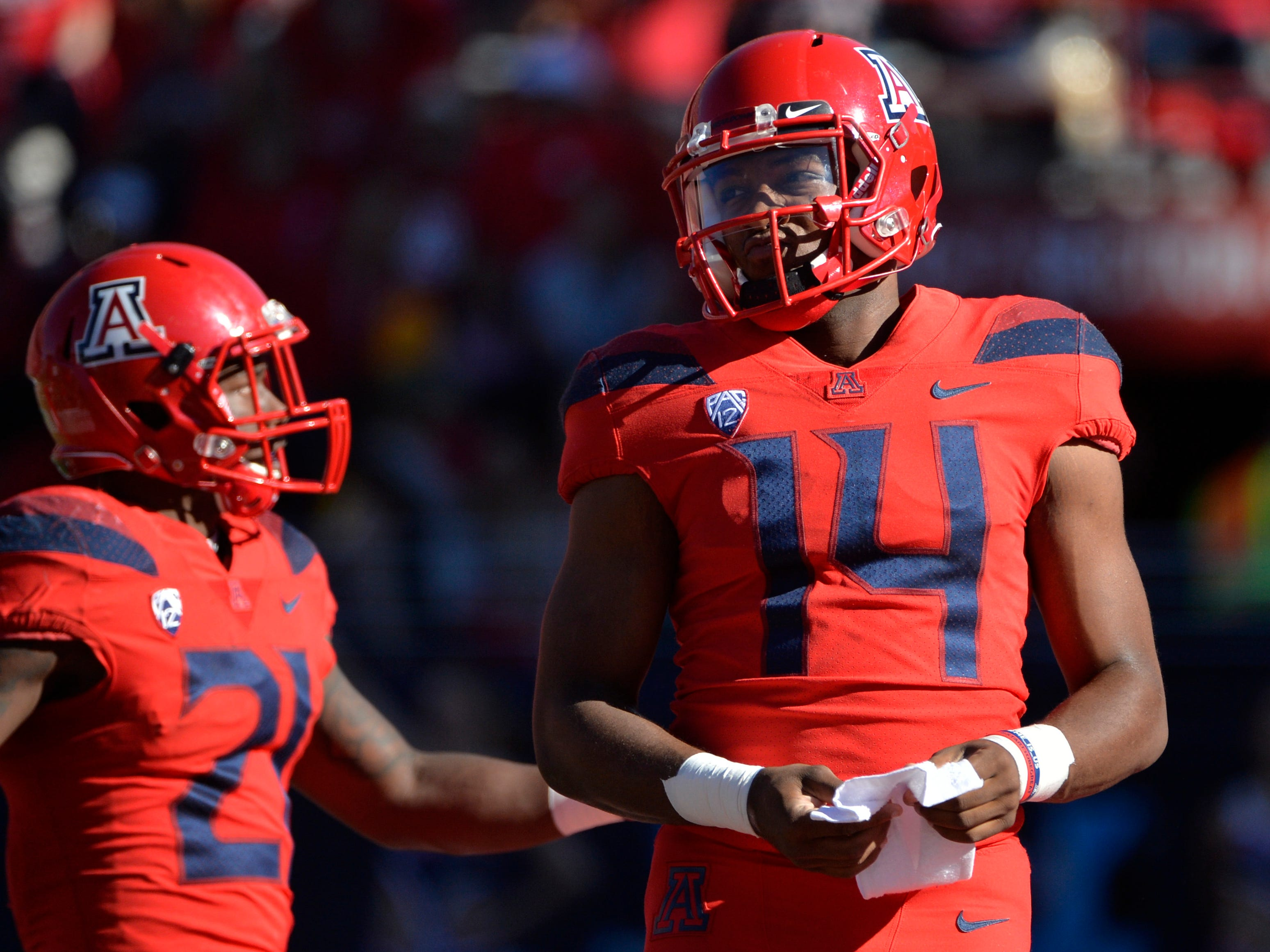Nov 24, 2018; Tucson, AZ, USA; Arizona Wildcats quarterback Khalil Tate (14) and running back J.J. Taylor (21) line up before a play against the Arizona State Sun Devils at Arizona Stadium. Mandatory Credit: Casey Sapio-USA TODAY Sports