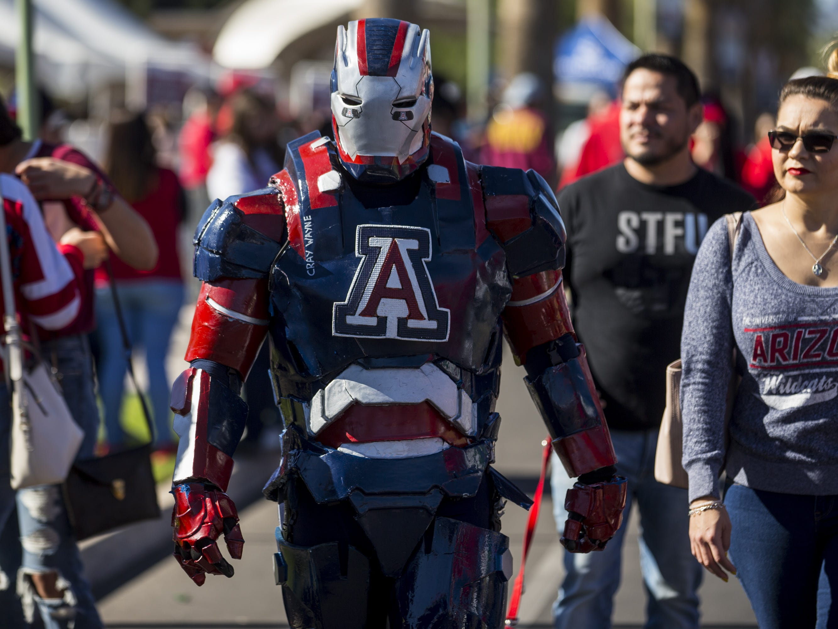 Jaime Reyes walks around the tailgating area before the Territorial Cup football game on Saturday, Nov. 24, 2018, at Arizona Stadium in Tucson, Ariz.