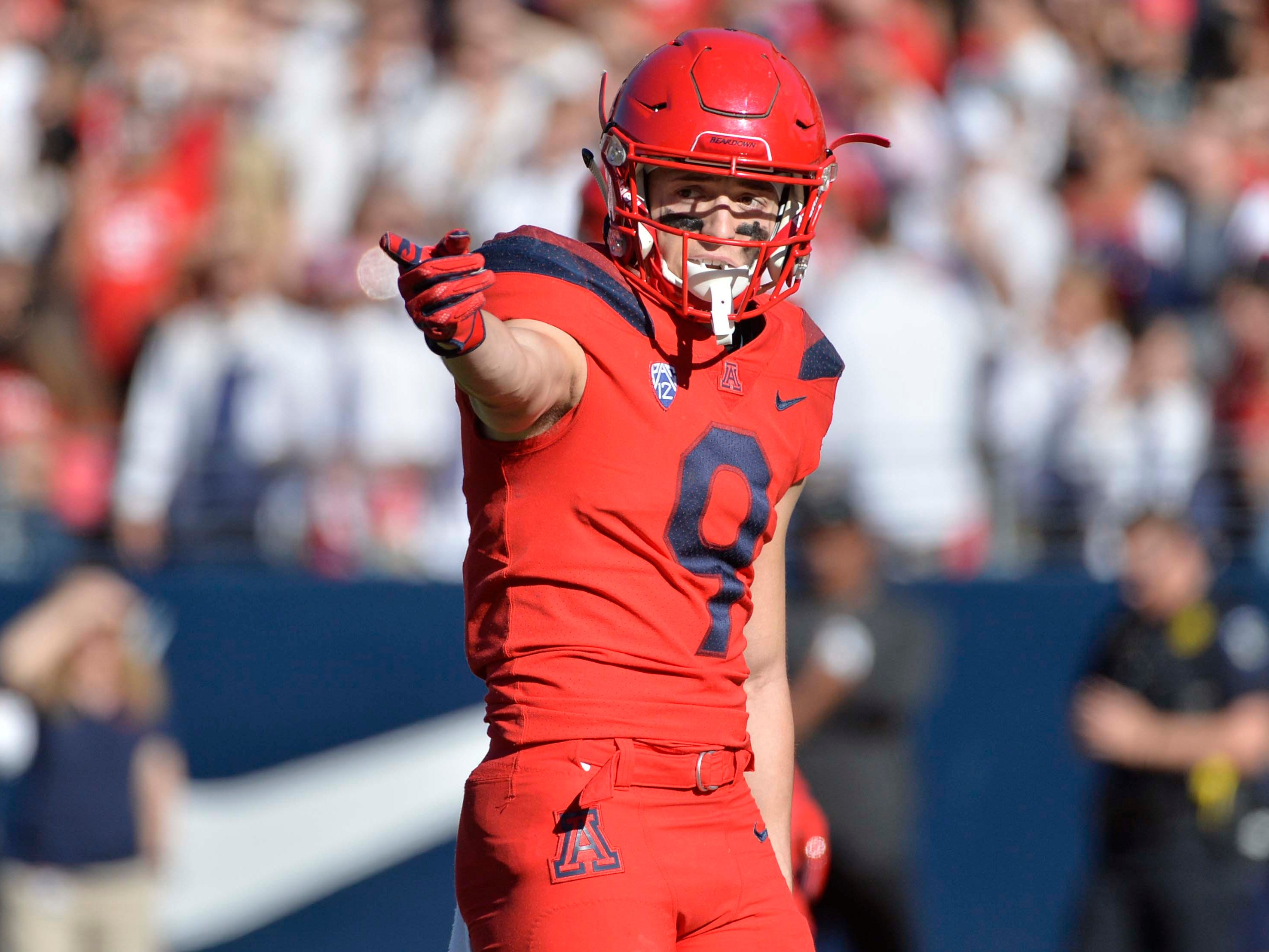 Nov 24, 2018; Tucson, AZ, USA; Arizona Wildcats wide receiver Tony Ellison (9) signals during the first half against the Arizona State Sun Devils in the Territorial Cup at Arizona Stadium. Mandatory Credit: Casey Sapio-USA TODAY Sports