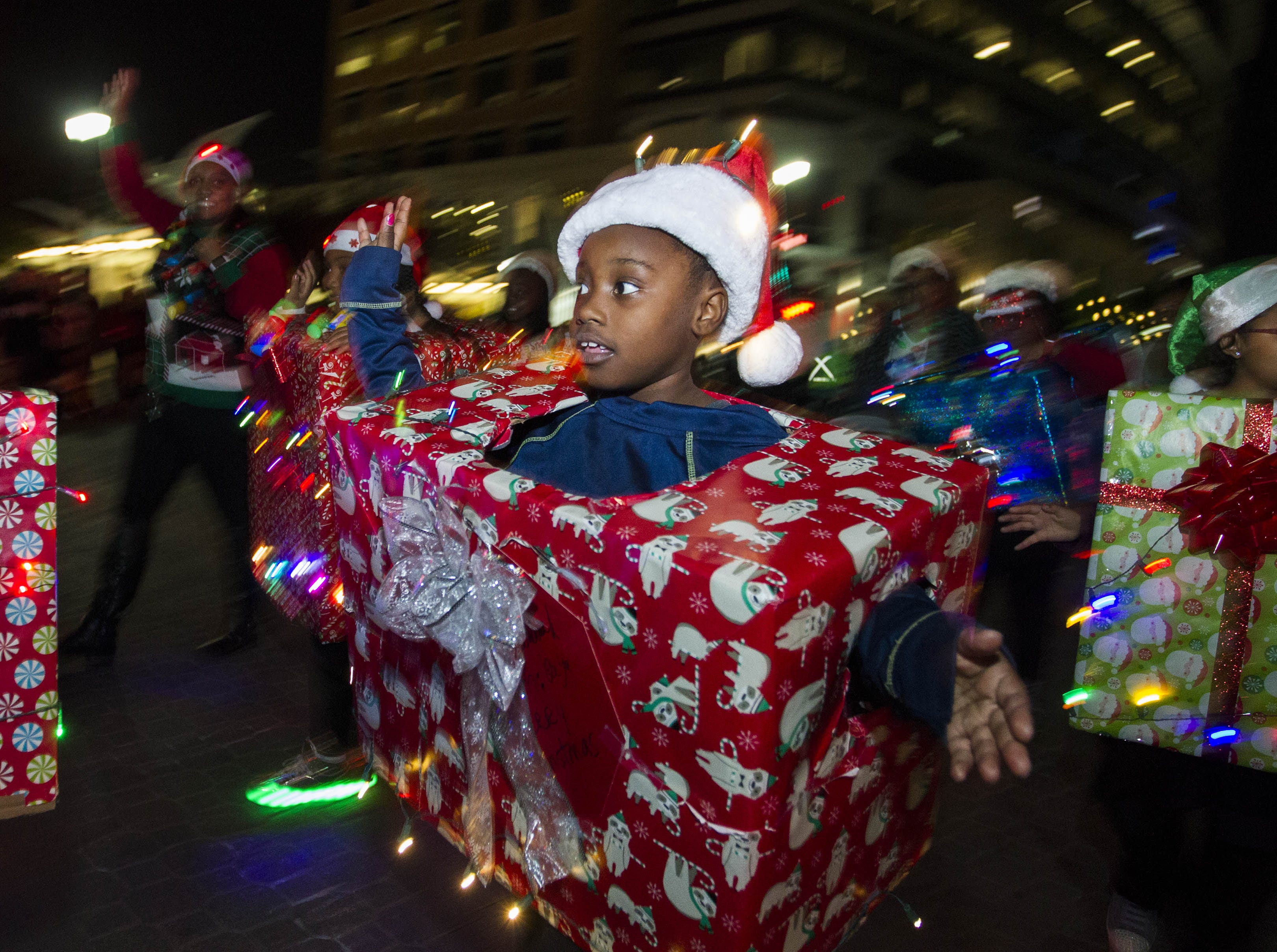 Little Light Parade participants have fun entertaining during the 2018 Fantasy of Lights Parade on Mill Ave. Friday, Nov. 23, 2018.