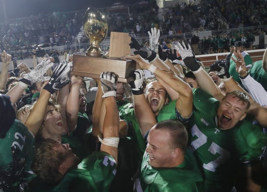Thatcher celebrates after winning the 2A State Championship over Round Valley on Nov. 23 at Campo Verde High School.