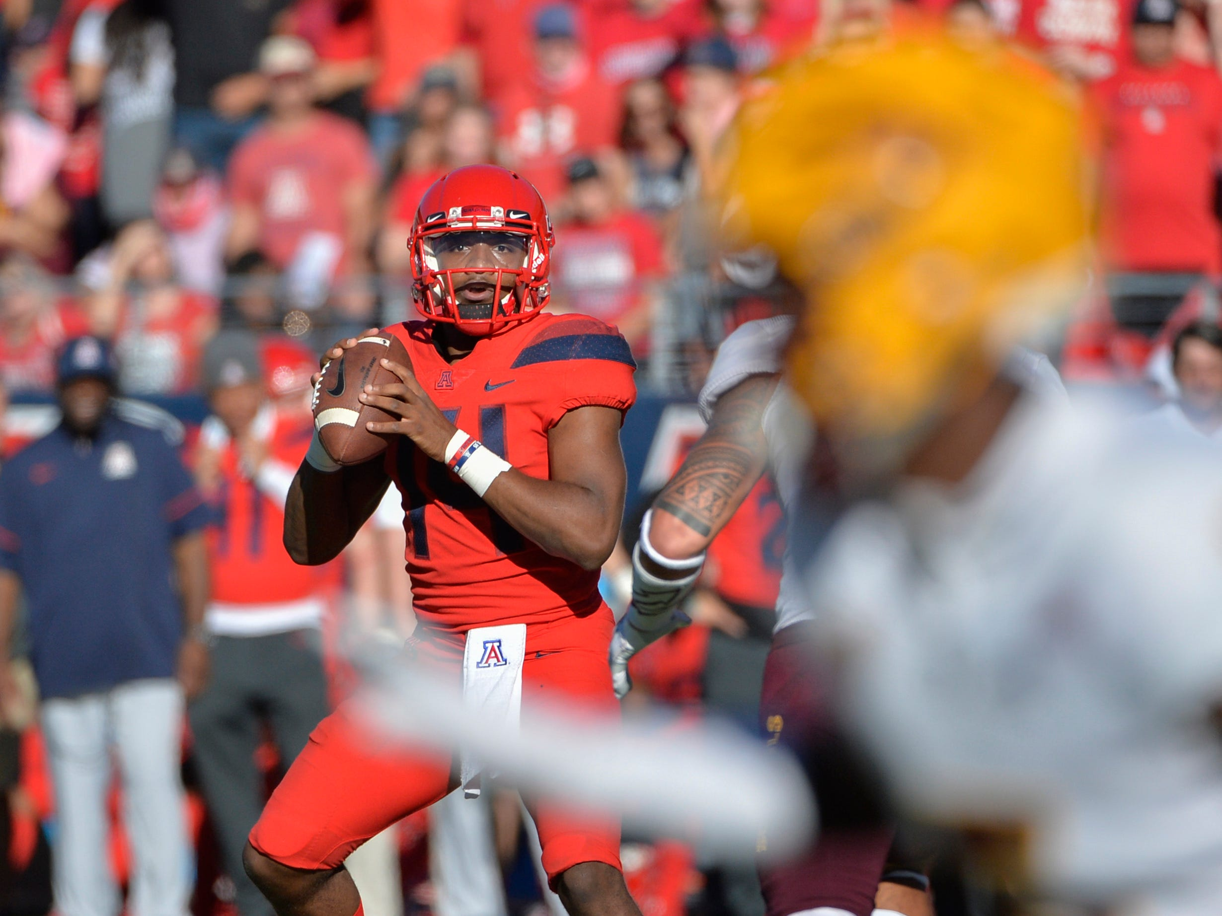 Nov 24, 2018; Tucson, AZ, USA; Arizona Wildcats quarterback Khalil Tate (14) drops back to pass the ball against the Arizona State Sun Devils during the first half of the Territorial Cup at Arizona Stadium. Mandatory Credit: Casey Sapio-USA TODAY Sports