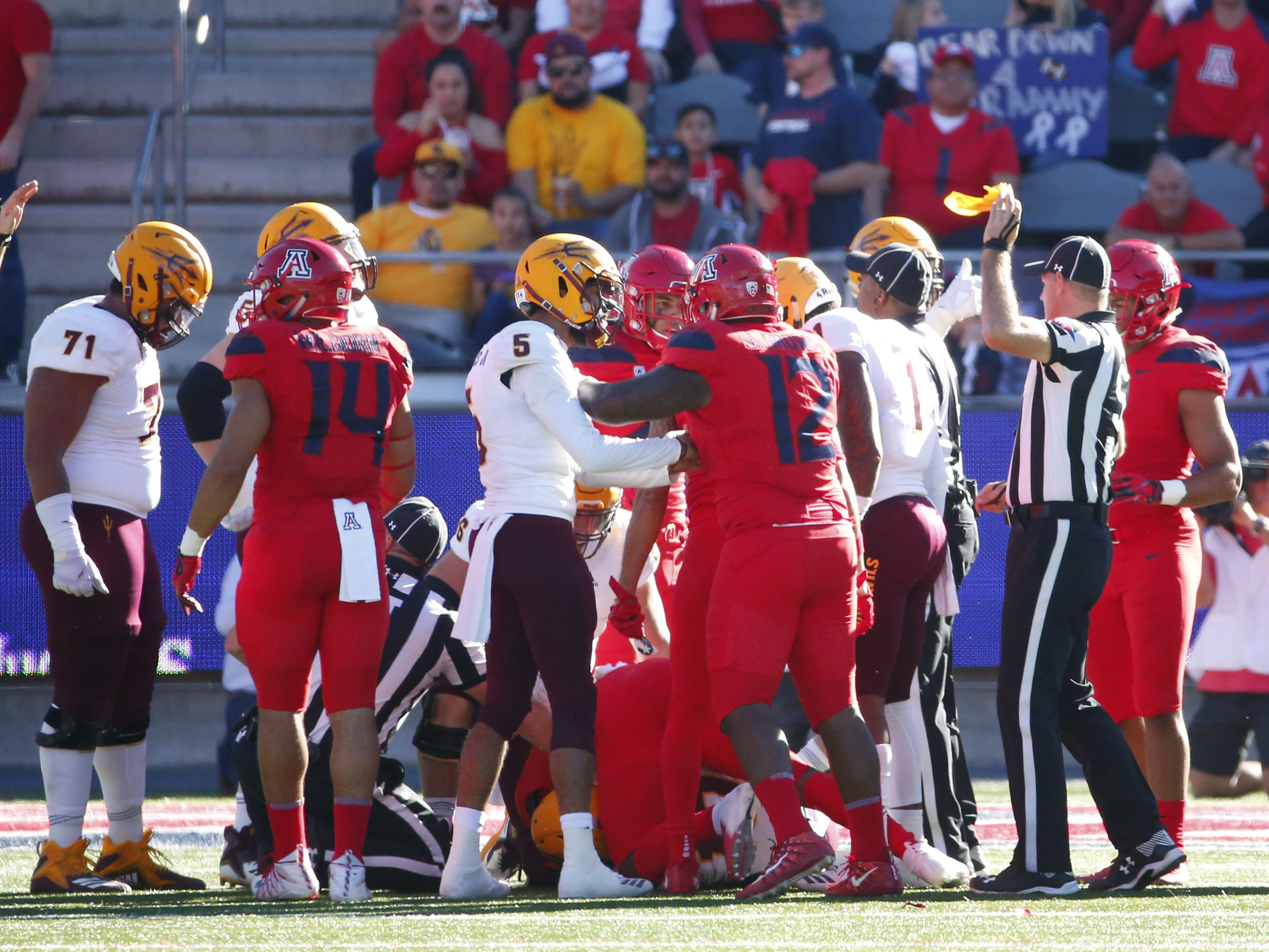 After the Arizona State Sun Devils fumble bounced around and a flag the ball was ruled recovered by ASU during the Territorial Cup football game against the Arizona Wildcats at Arizona Stadium in Tucson on November 24.