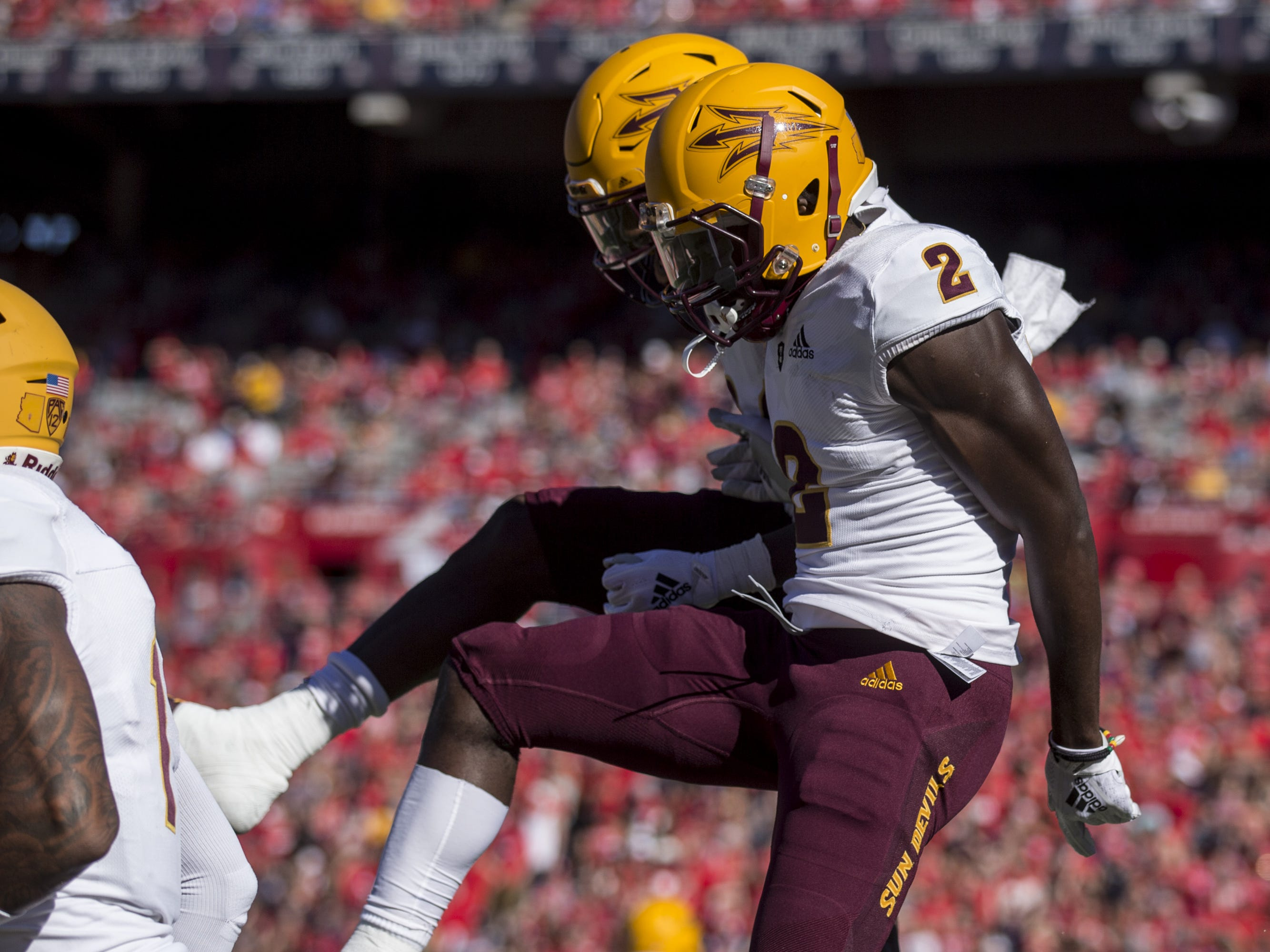 Arizona State's Brandon Aiyuk celebrates with Frank Darby after Aiyuk scored a touchdown reception against Arizona during the first half of the Territorial Cup on Saturday, Nov. 24, 2018, at Arizona Stadium in Tucson, Ariz.