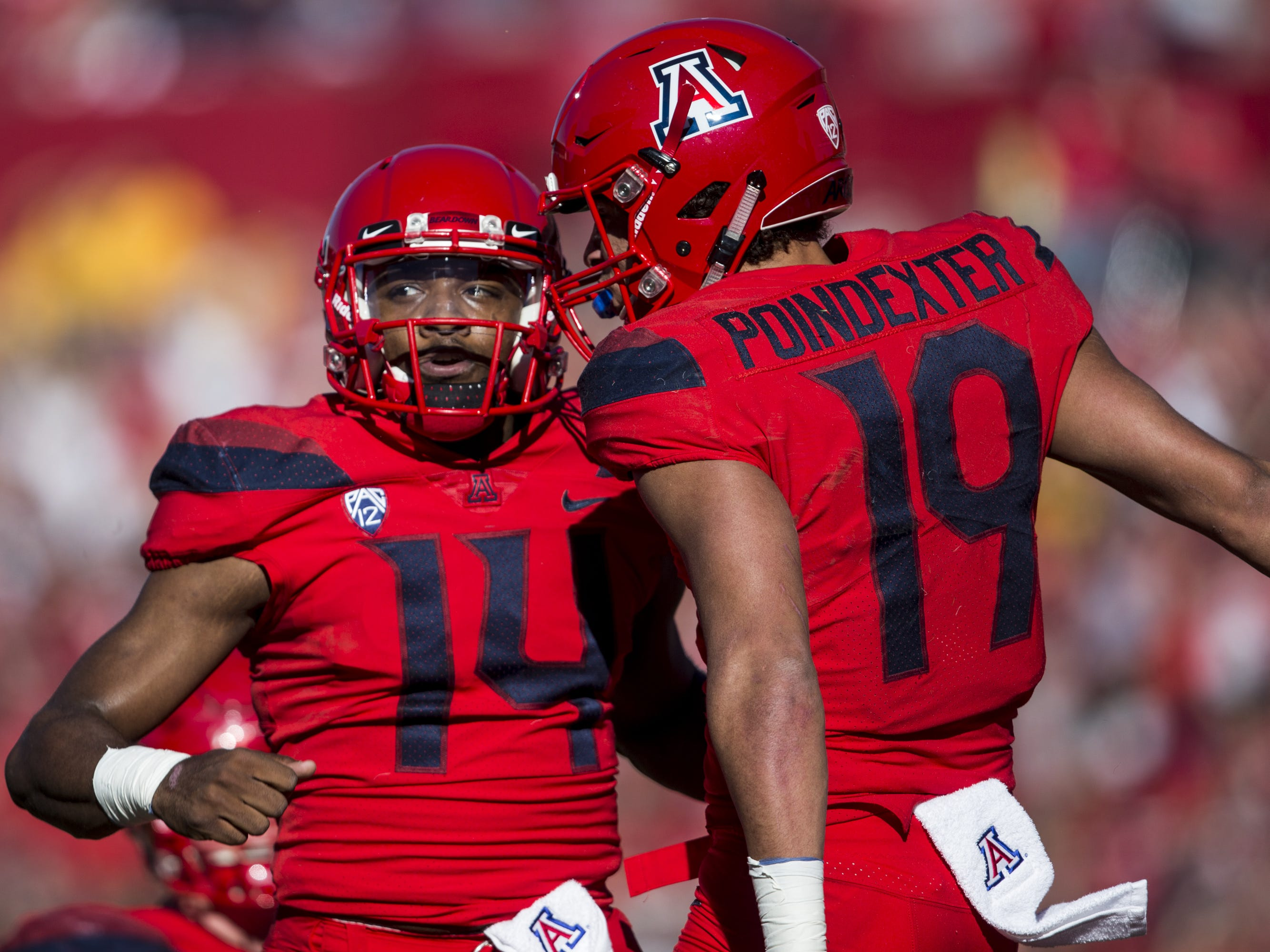 Arizona's Khalil Tate celebrates with Shawn Poindexter after throwing a touchdown to him against Arizona State during the first half of the Territorial Cup on Saturday, Nov. 24, 2018, at Arizona Stadium in Tucson, Ariz.