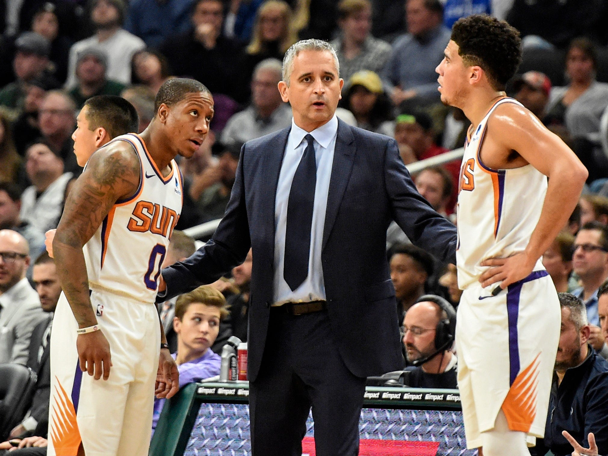 Suns coach Igor Kokoskov talks to guards Isaiah Canaan and Devin Booker during the first quarter of a game against the Milwaukee Bucks.