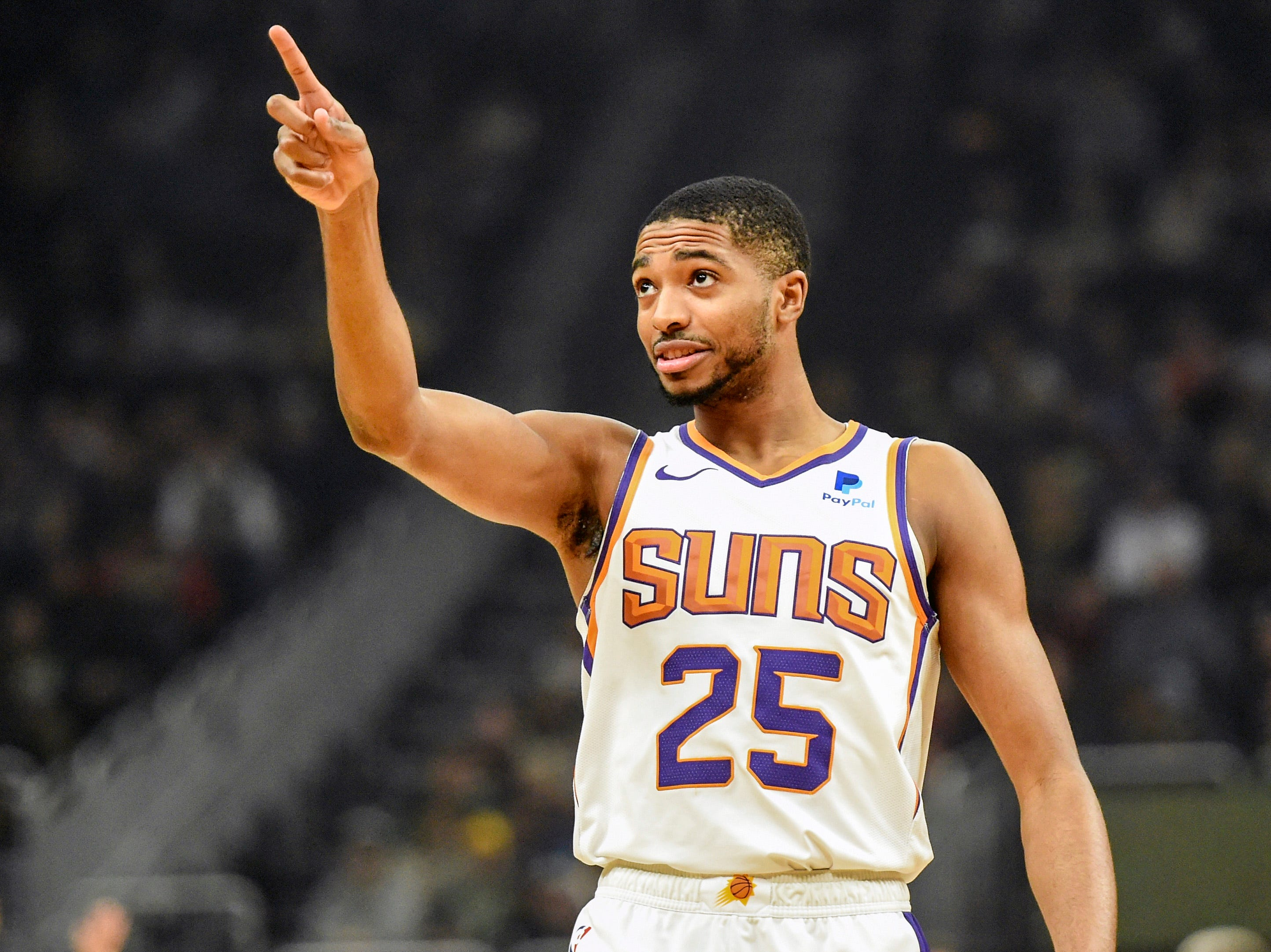 Suns forward Mikal Bridges gestures during the first quarter of a game Nov. 23 against the Milwaukee Bucks.