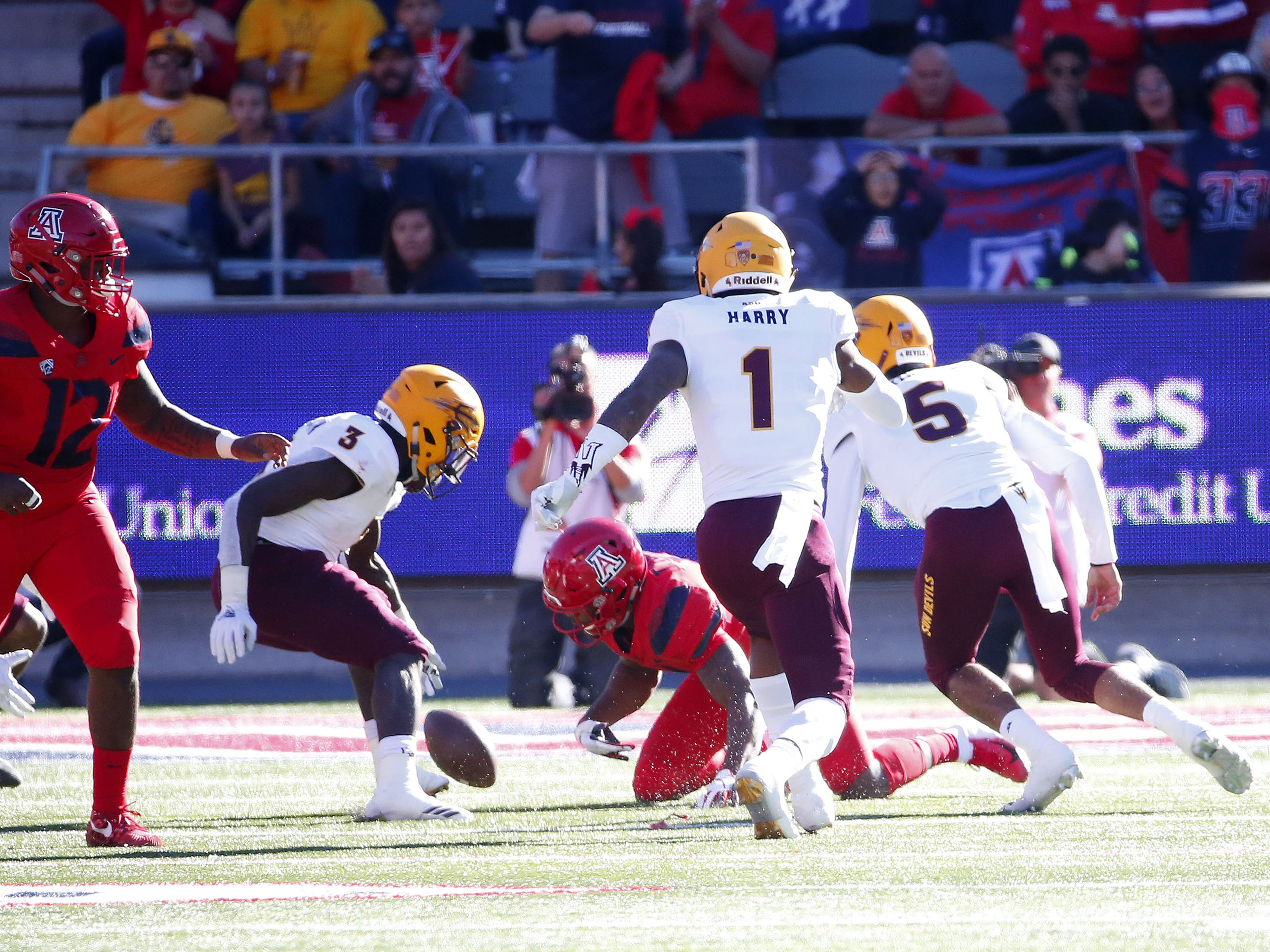 Arizona State Sun Devils running back Eno Benjamin (3) fumbles the ball during the Territorial Cup football game against the Arizona Wildcats at Arizona Stadium in Tucson on November 24.