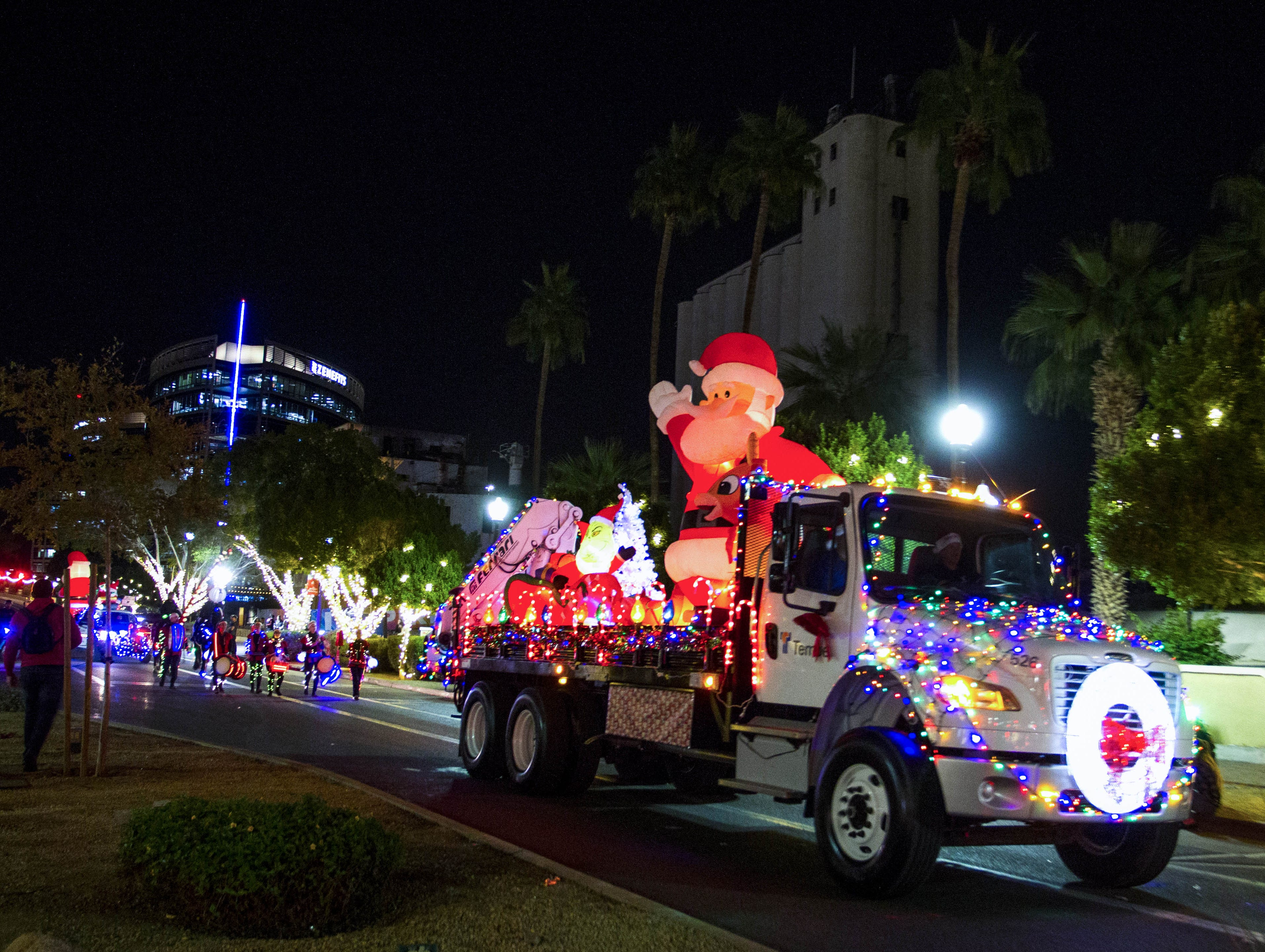 Christmas displays roll along Mill Avenue during the 2018 Fantasy of Lights Parade, Friday, Nov. 23, 2018.