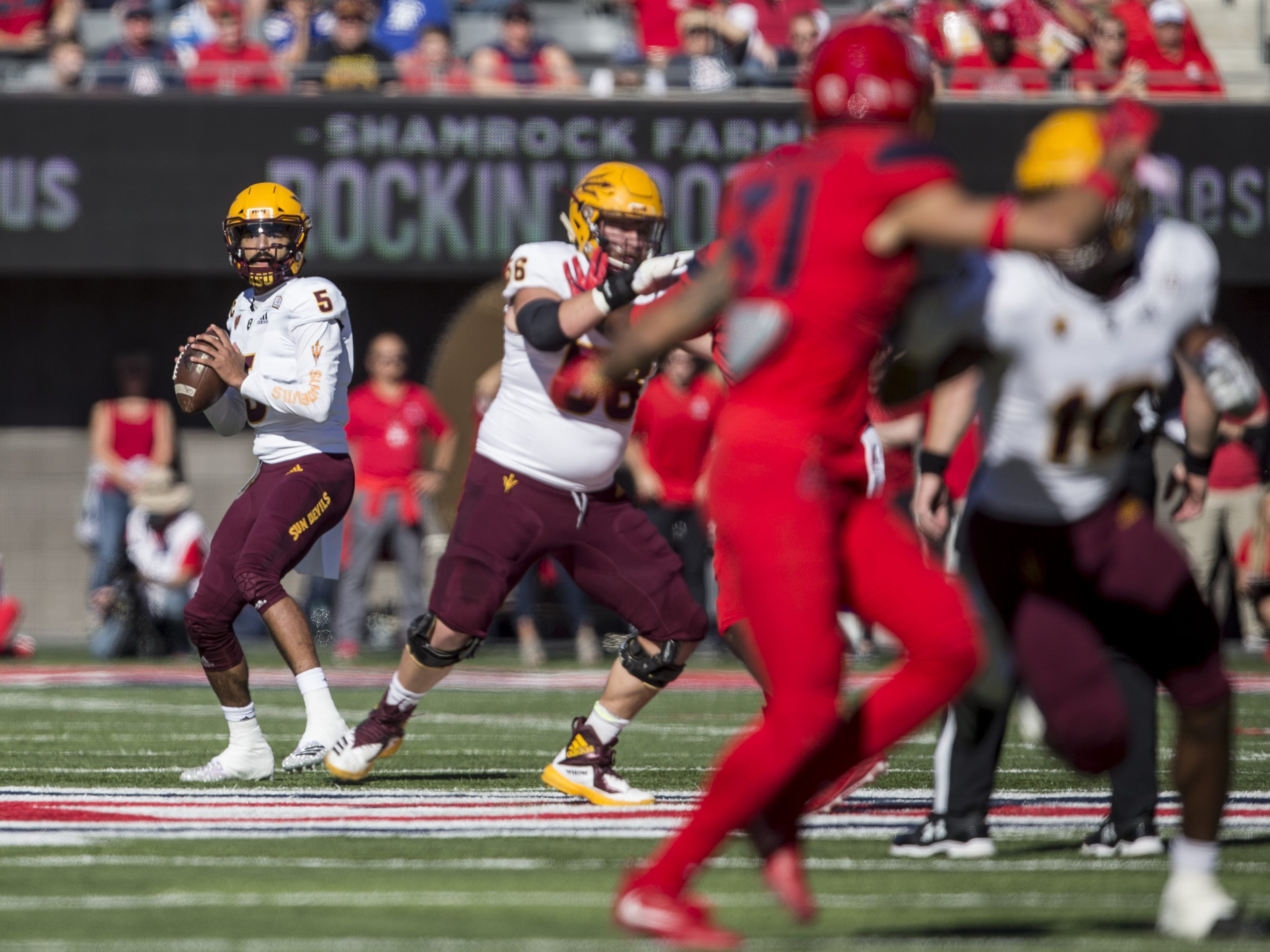 Arizona State's Manny Wilkins looks to pass against Arizona during the first half of the Territorial Cup on Saturday, Nov. 24, 2018, at Arizona Stadium in Tucson, Ariz.