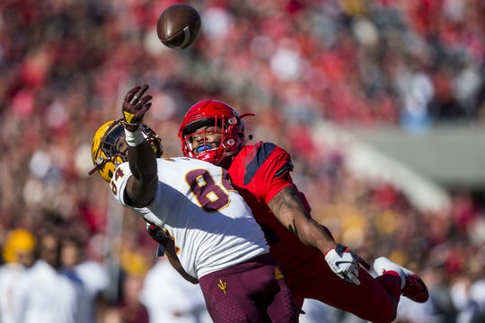 Arizona's Troy Young is flagged for pass interference against Arizona State's Frank Darby during the first half of the Territorial Cup on Saturday, Nov. 24, 2018, at Arizona Stadium in Tucson, Ariz.
