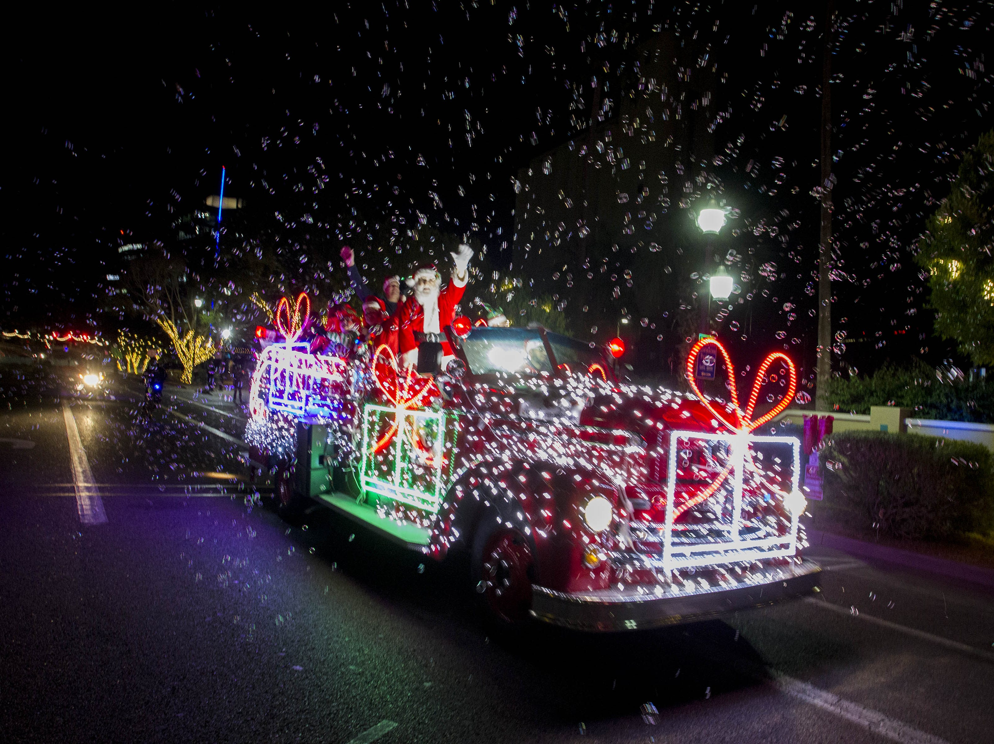 Santa Claus rides along Mill Avenue during the 2018 Fantasy of Lights Parade,  Friday Nov. 23, 2018.