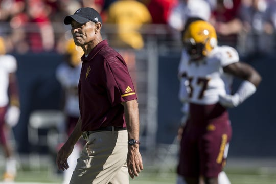 Arizona State head coach Herm Edwards watches his players warm up before the Territorial Cup football game on Saturday, Nov. 24, 2018, at Arizona Stadium in Tucson, Ariz.