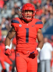 Nov 24, 2018; Tucson, AZ, USA; Arizona Wildcats linebacker Tony Fields II (1) celebrates after making a stop against the Arizona State Sun Devils during the first half of the Territorial Cup at Arizona Stadium. Mandatory Credit: Casey Sapio-USA TODAY Sports