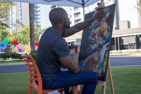 Aaron Allen Marner painted a commissioned art piece outside of FEZ restaurant on Small Business Saturday, November 24, 2018.