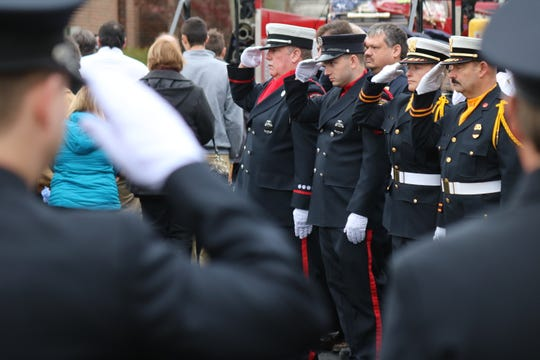 Fellow firefighters from throughout Ottawa County and the surrounding area gathered in Oak Harbor in 2018 for the funeral of Carroll Township firefighter Daniel Lucius.