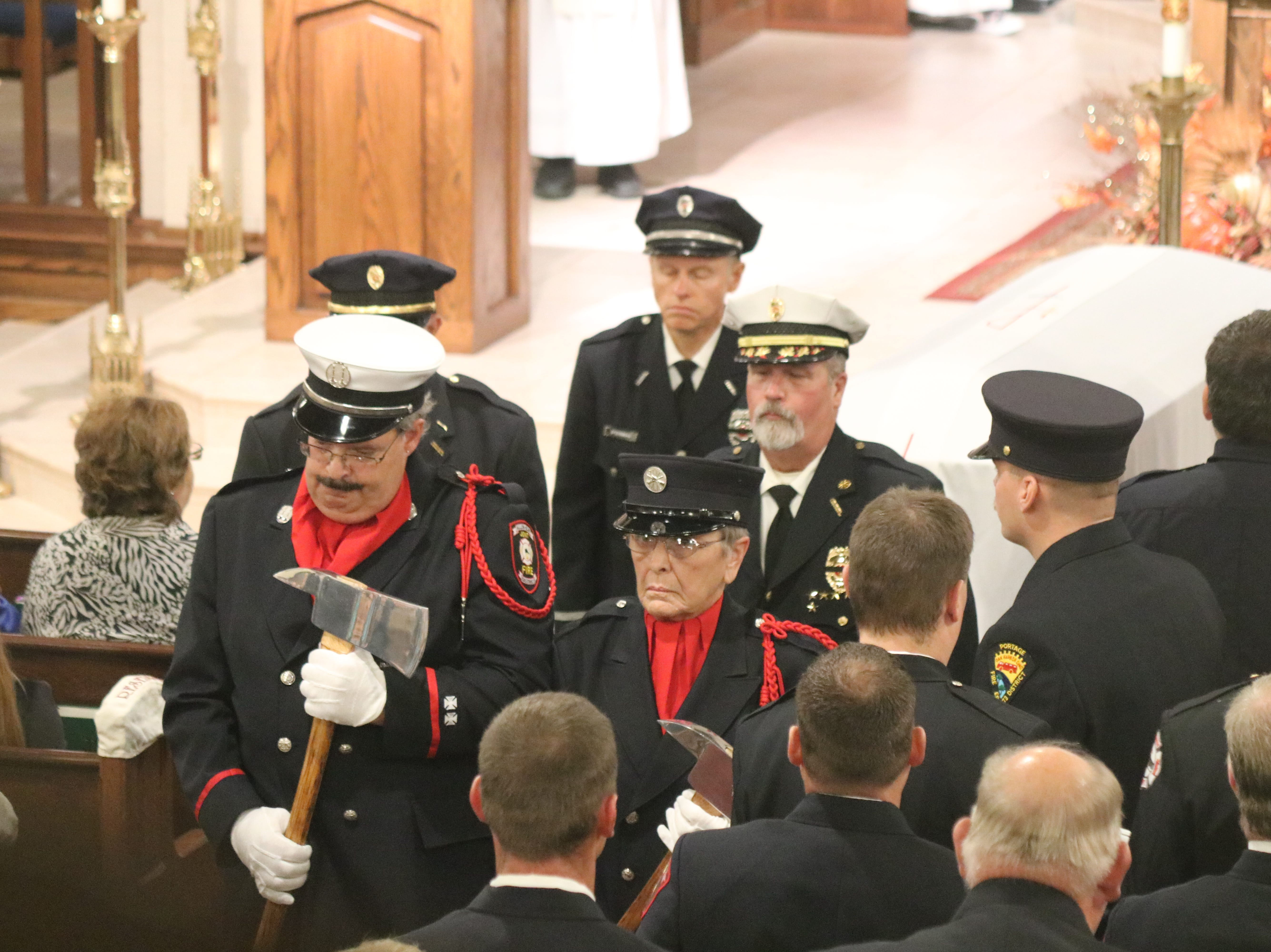 Family, friends and fellow first responders mourned the loss of one of their own as they gathered in Oak Harbor on Saturday for the funeral of Carroll Township firefighter Daniel Lucius.