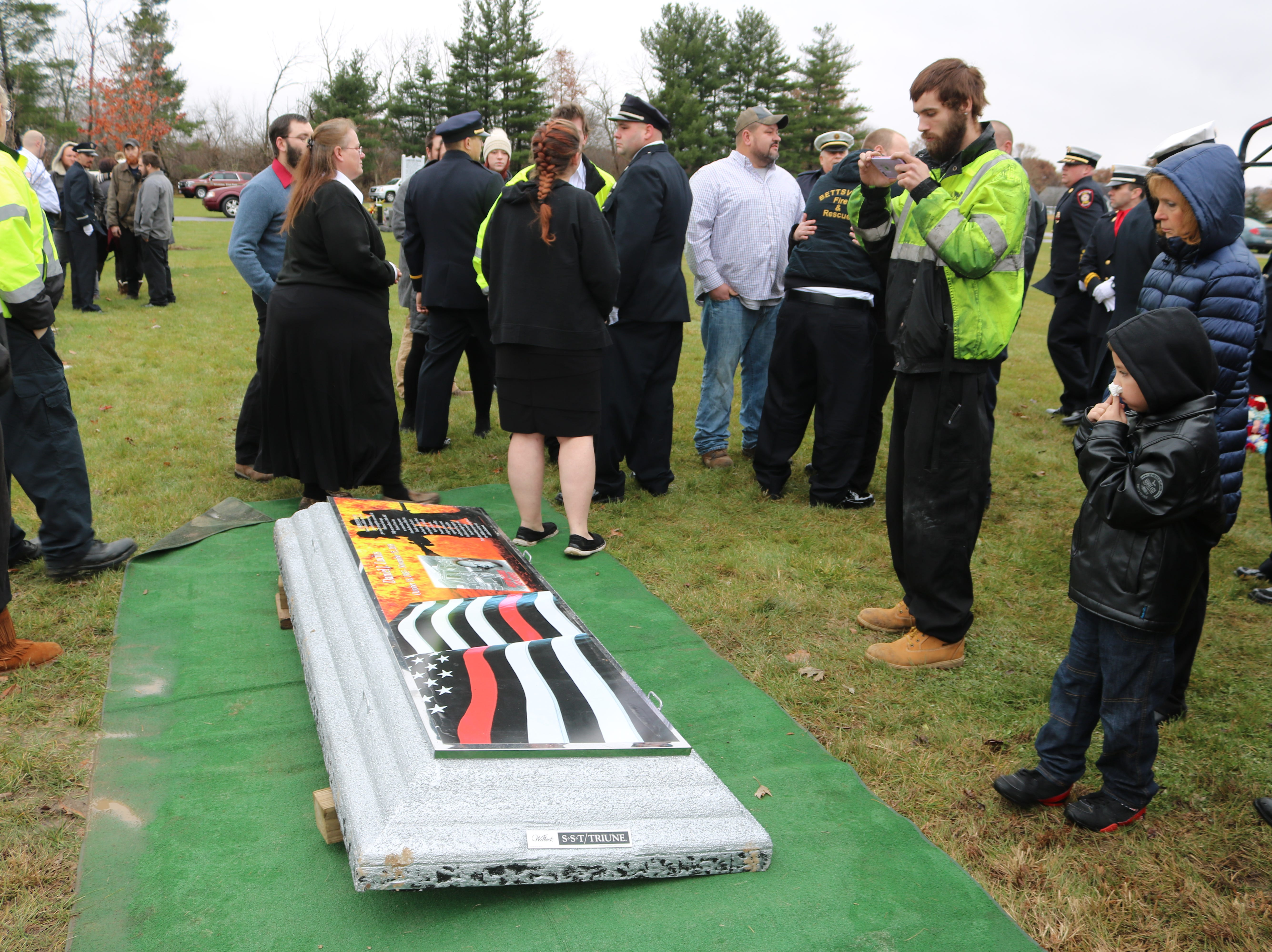 Fellow firefighters and other first responders from throughout Ottawa County and the surrounding area gathered in Oak Harbor on Saturday for the funeral of Carroll Township firefighter Daniel Lucius.