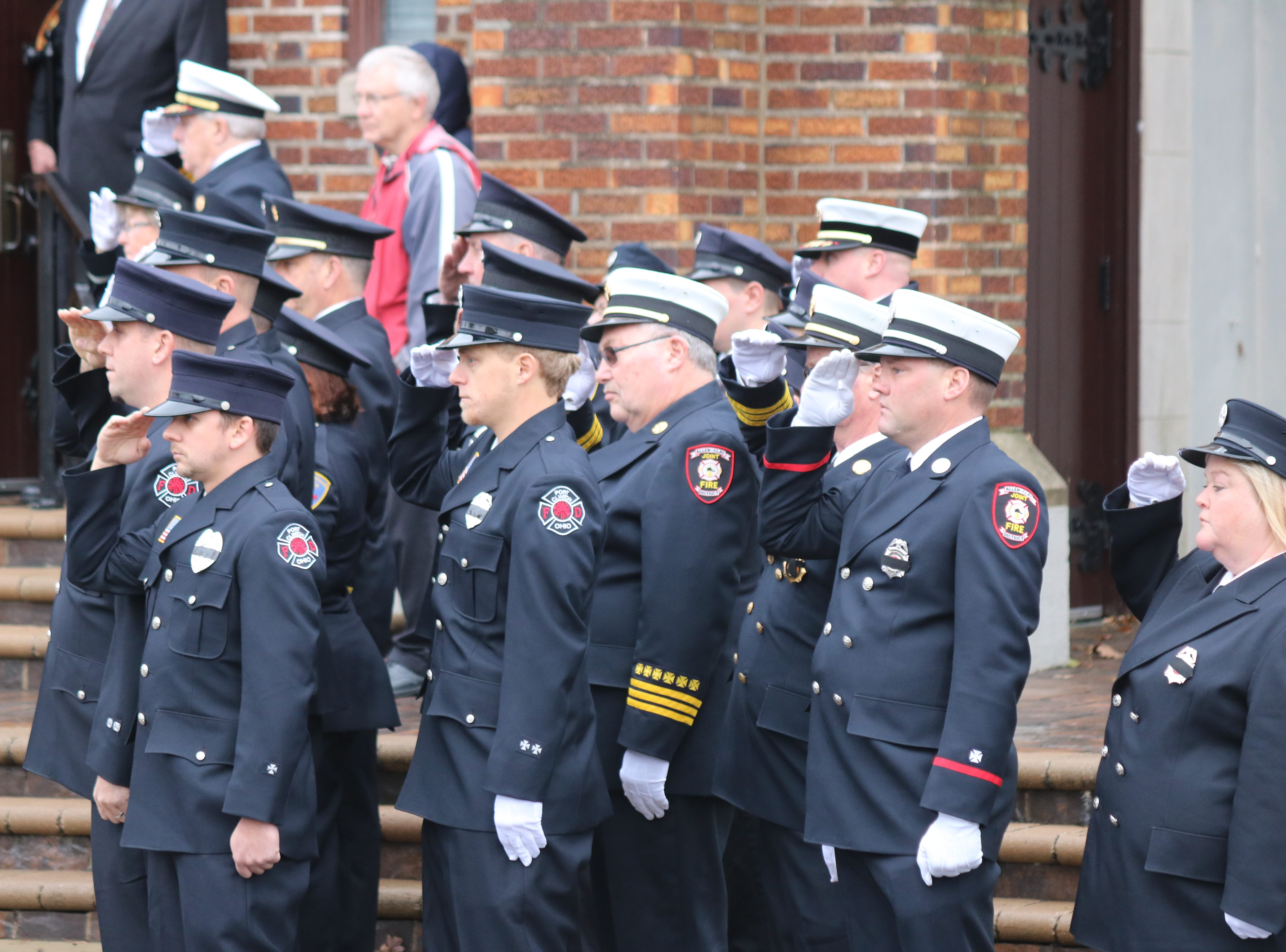 Family, friends and follow first responders mourned the loss of one of their own as they gathered in Oak Harbor on Saturday for the funeral of Carroll Township firefighter Daniel Lucius.