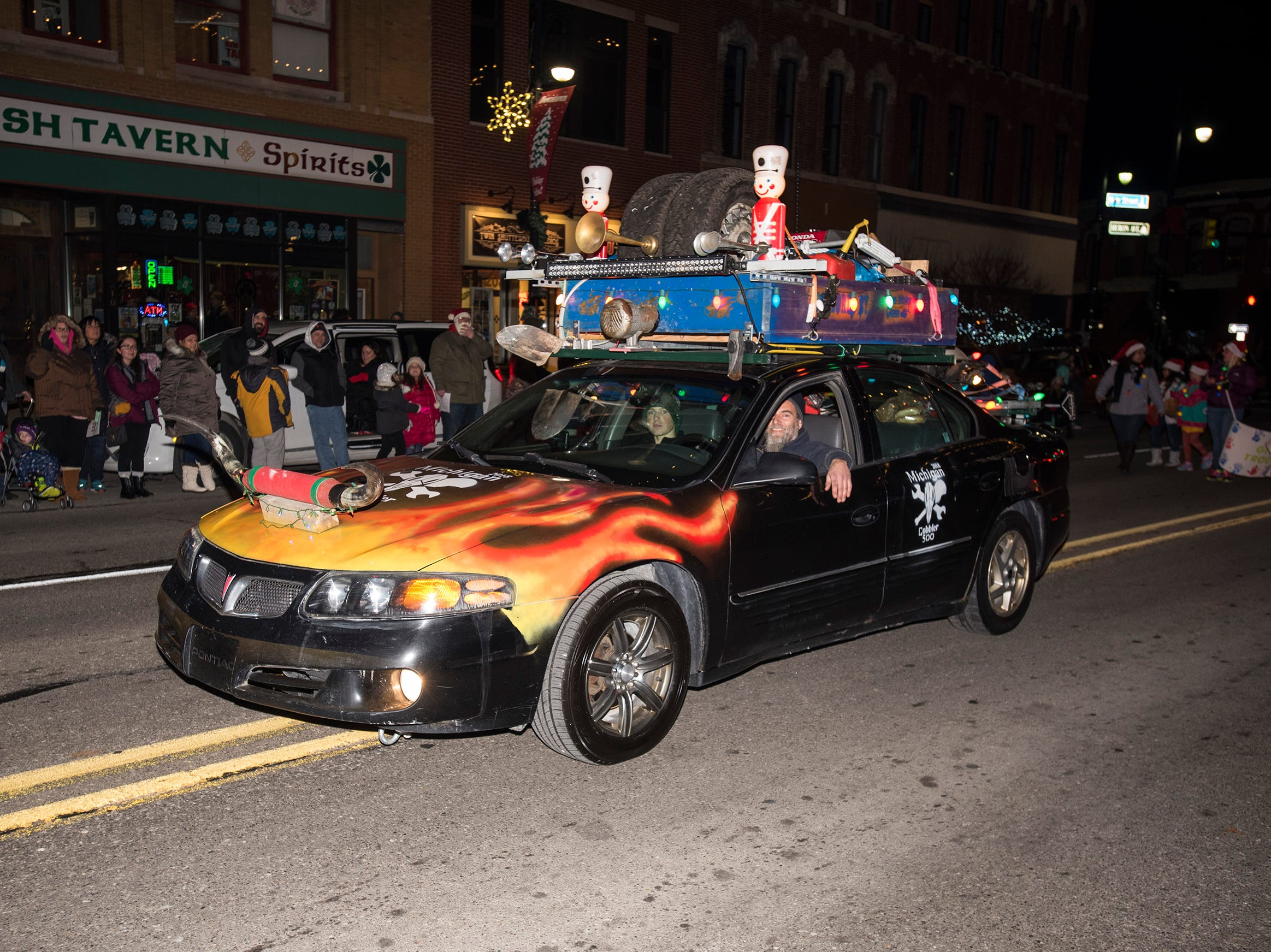 Floats drive along Huron Avenue during Sperry's Santa Claus Parade Friday, Nov. 23, 2018 in downtown Port Huron.