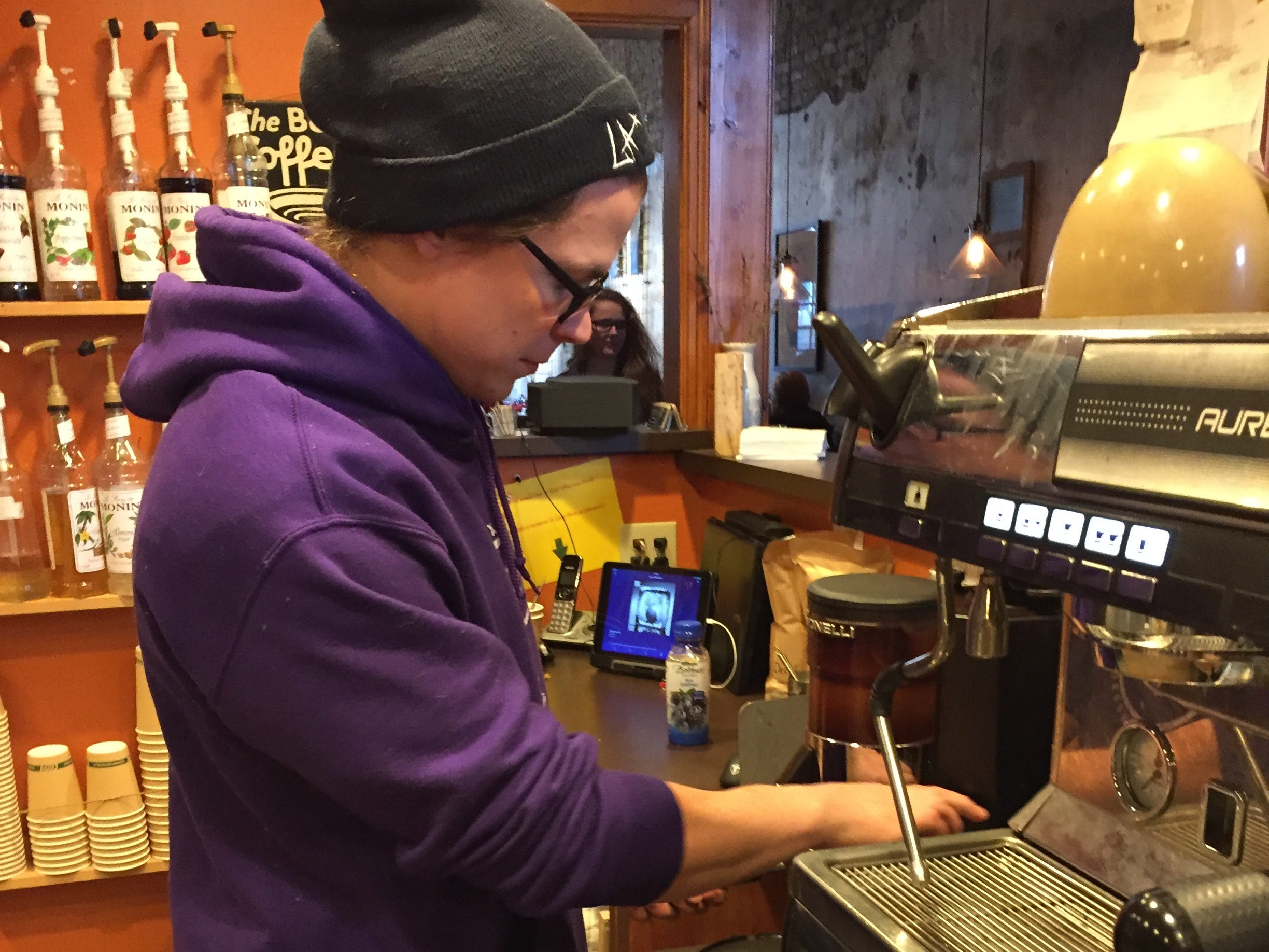 Nathaniel Bottenfield prepares a coffee drink at the Exquisite Corpse Coffeehouse during Small Business Saturday in Port Huron.
