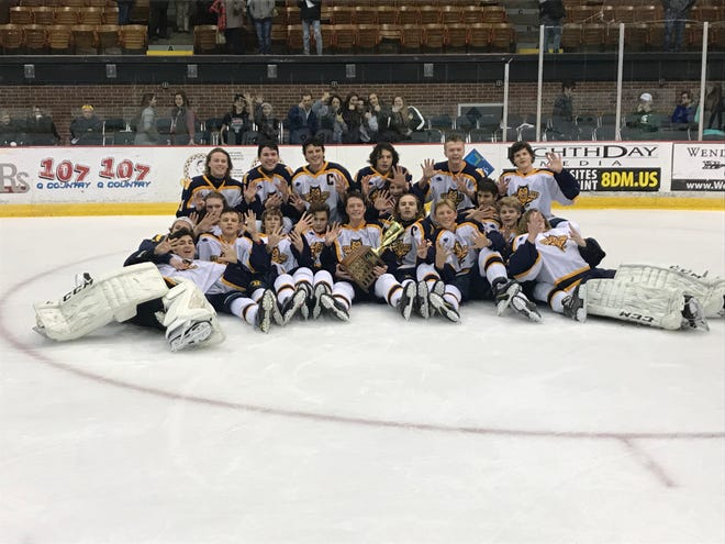 The Port Huron Northern hockey team poses for a photo after winning the Larry Manz Tournament.