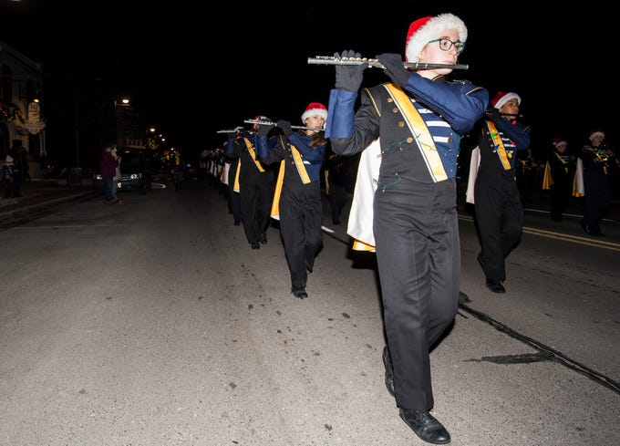 Members of the Port Huron Northern marching band march in Sperry's Santa Claus Parade Friday, Nov. 23, 2018 in downtown Port Huron.