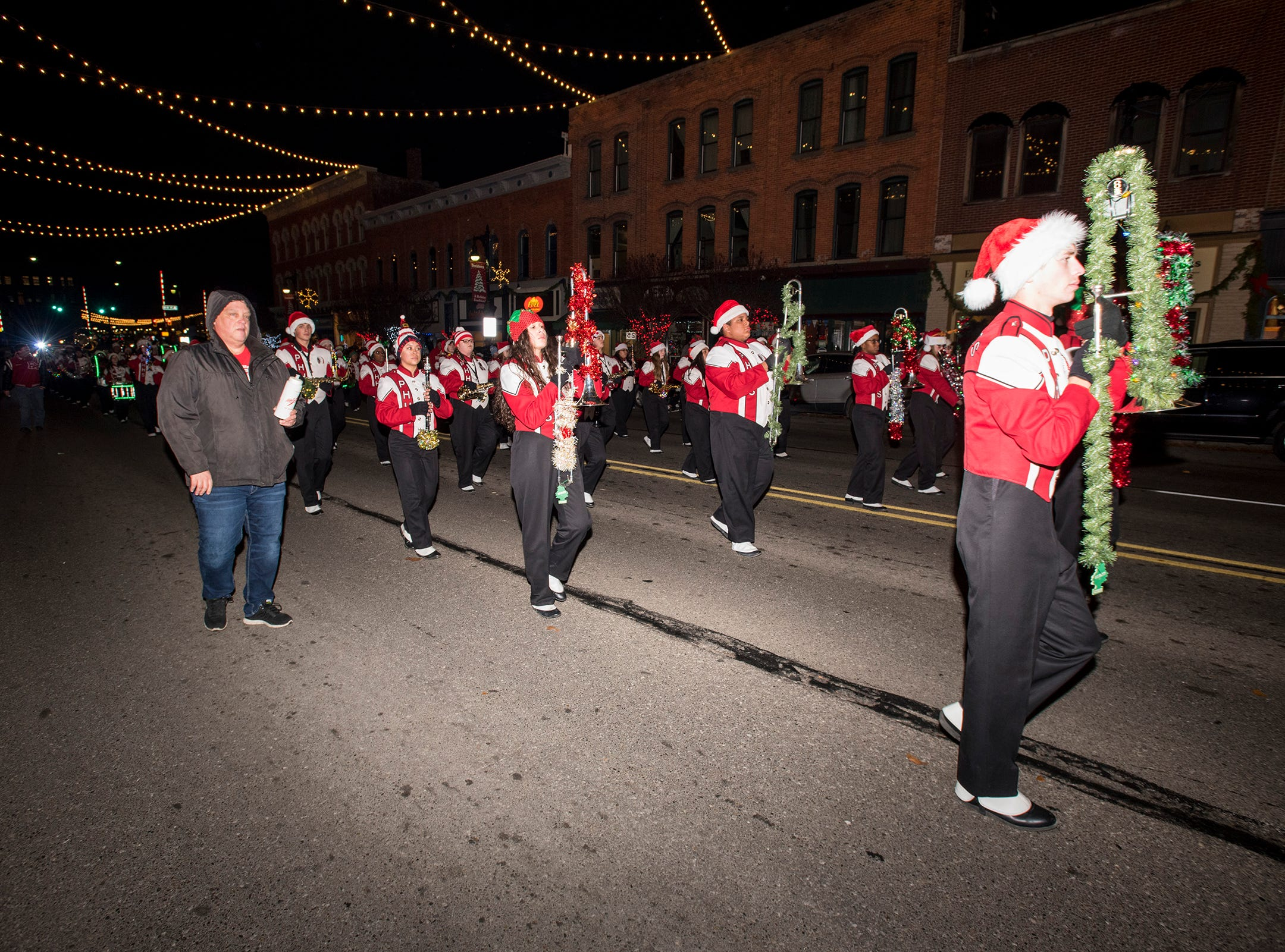 Members of the Port Huron High School marching band march in Sperry's Santa Claus Parade Friday, Nov. 23, 2018 in downtown Port Huron.