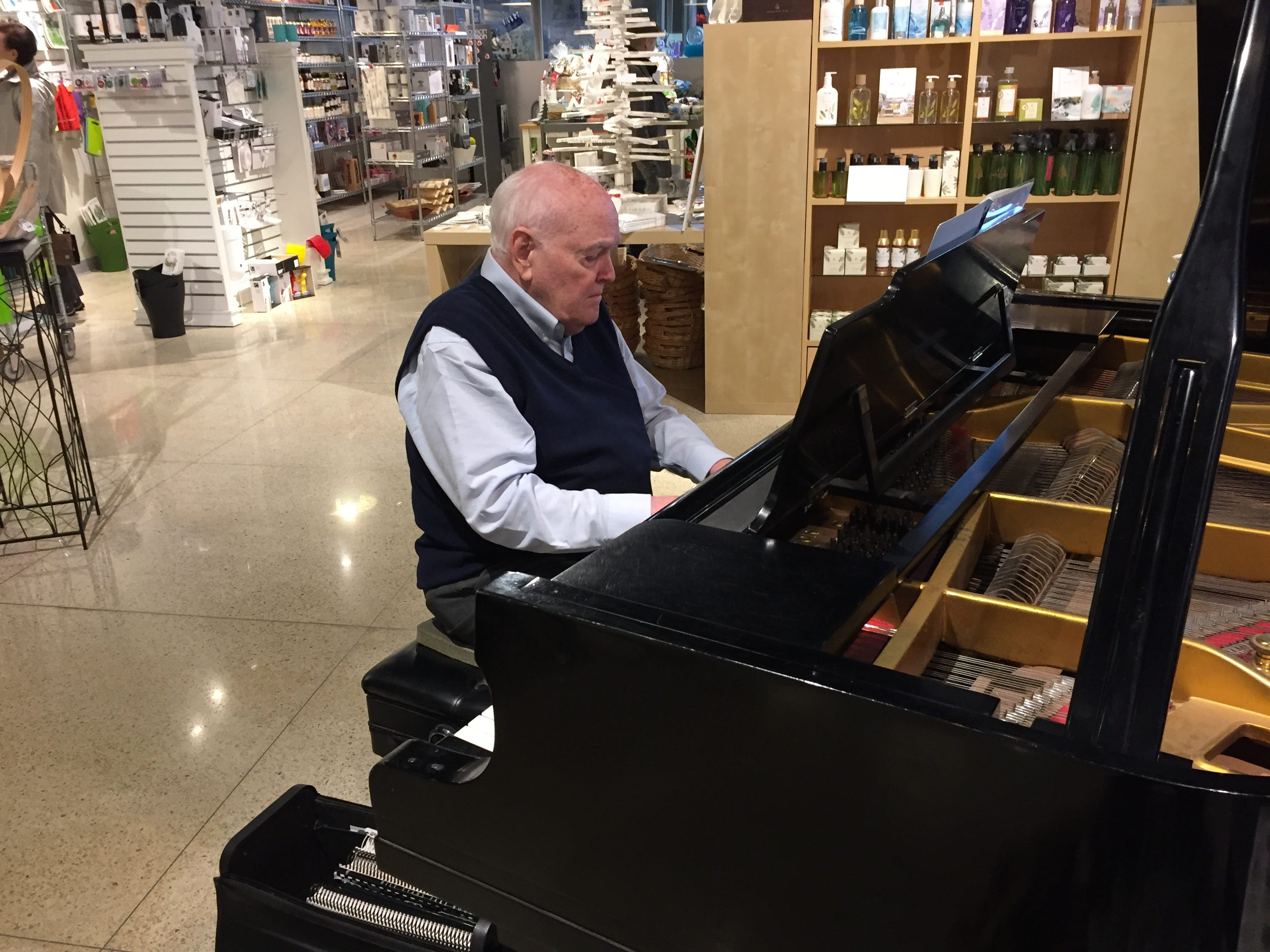 Mike Cogley plays piano at Weekends during Small Business Saturday in Port Huron.