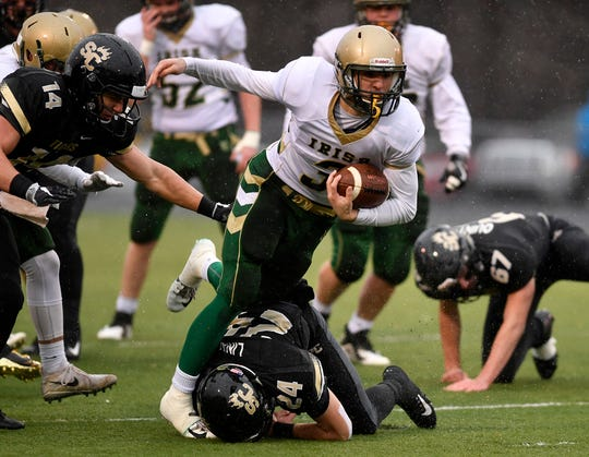 York Catholic's Cole Witman looks for running room vs. Southern Columbia on Saturday. The Fighting Irish lost the PIAA Class 2-A football quarterfinal, 56-23. The Irish were the last York-Adams League team still left playing in the football postseason. John A. Pavoncello photo