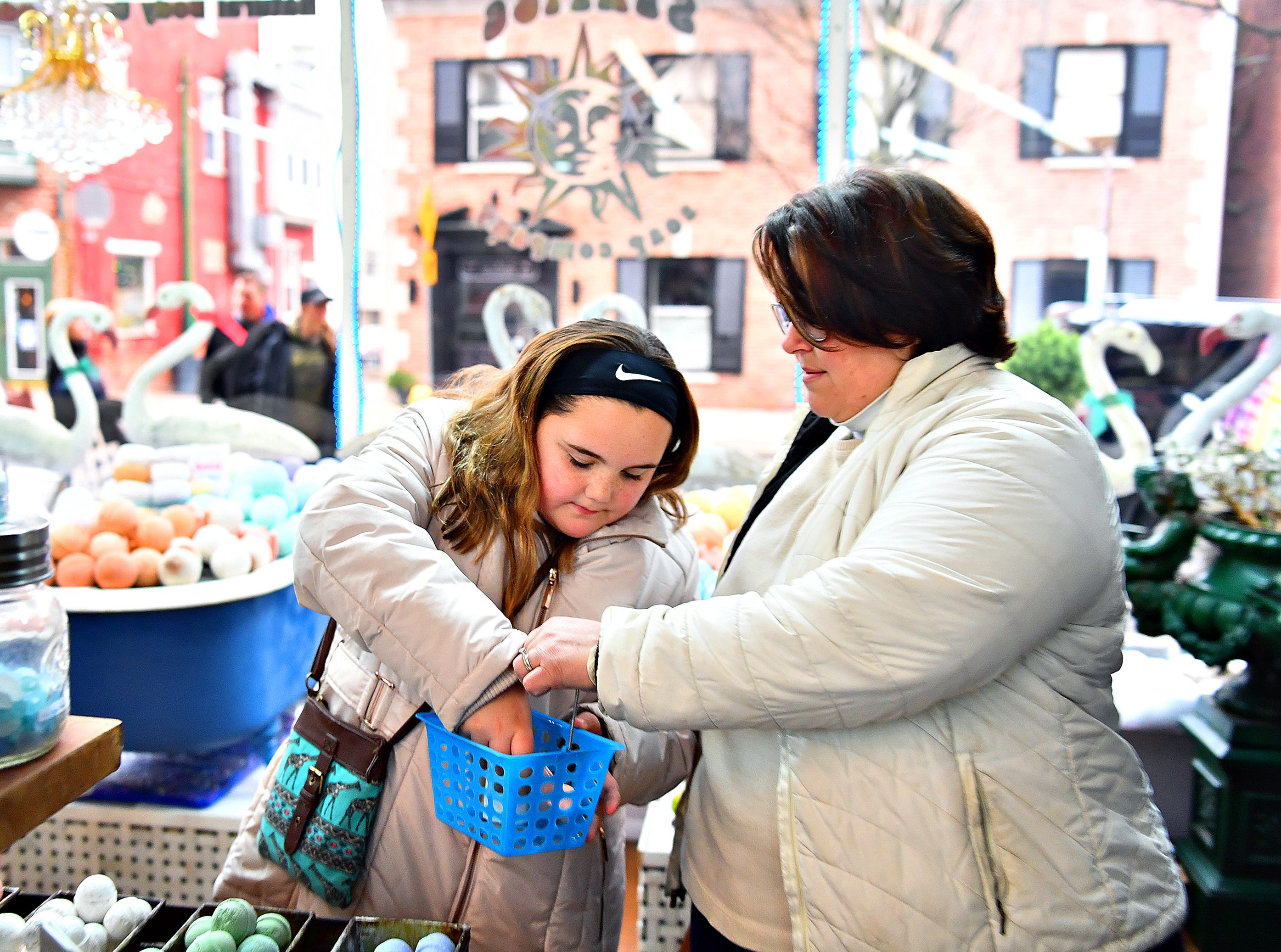 Kathy Harshall, right, and her daughter Avery Harshall, 11, both of Springettsbury Township, shop during Small Business Saturday at Sunrise Soap Co. in York City, Saturday, Nov. 24, 2018. Dawn J. Sagert photo