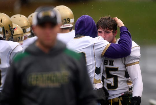 Defensive lineman Michael Back gets a hug from a York Catholic teammate after being pulled from the game late in the fourth quarter of the PIAA Class 2-A quarterfinal football game, Saturday, November 24, 2018. John A. Pavoncello photo