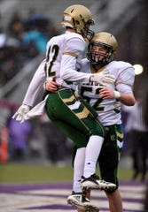 York Catholic's Benjamin Nelson-Moir, left, and Luke Brauer celebrate Nelson-Moir's touchdown against Southern Columbia last season during a PIAA Class 2-A quarterfinal football game in Shamokin. Nelson-Moir will return for the Fighting Irish this season. York Catholic finished 12-1 last season.   John A. Pavoncello photo