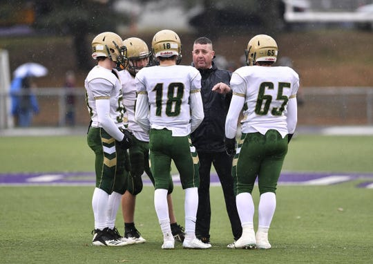 York Catholic head coach Eric Depew talks with the team captains before playing Southern Columbia in a PIAA Class 2-A State Playoff game Saturday, Nov. 24, in Shamokin. John A. Pavoncello photo