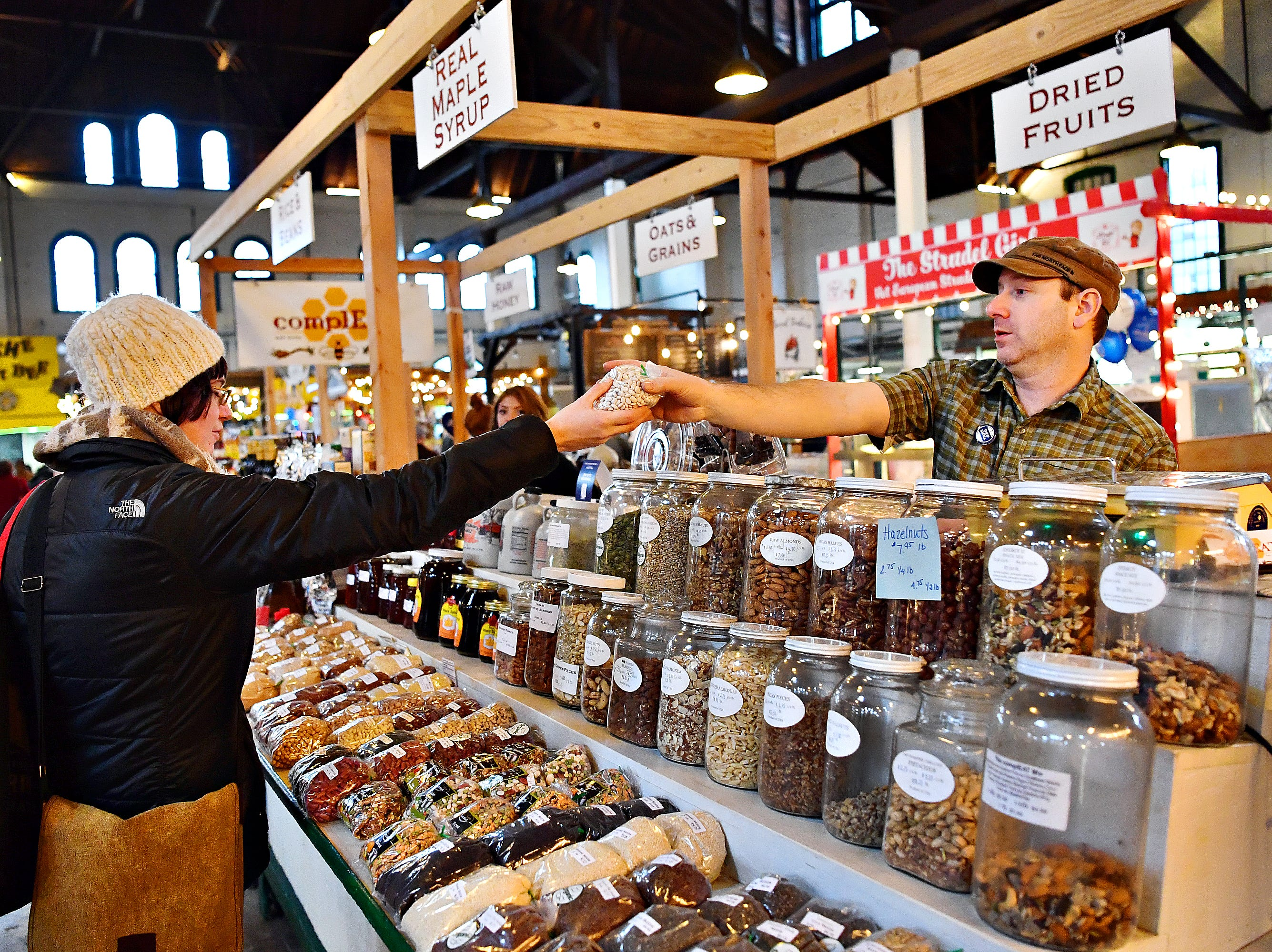 Owner Kevin Westover, right, of ComplEAT, hands customer Amanda Gearhart, her order during Small Business Saturday at Central Market in York City, Saturday, Nov. 24, 2018. Dawn J. Sagert photo