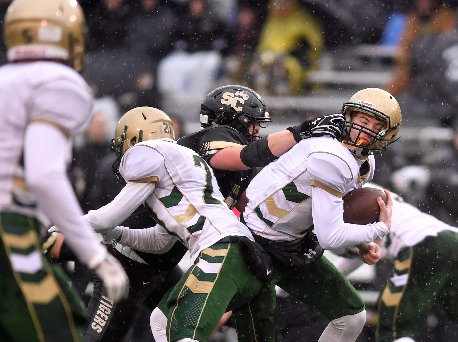 York Catholic quarterback Mitchell Galentine is facemasked by Payton Pursel of Southern Columbia during the PIAA Class 2-A quarterfinal football game in Shamokin, Saturday, November 24, 2018. 
