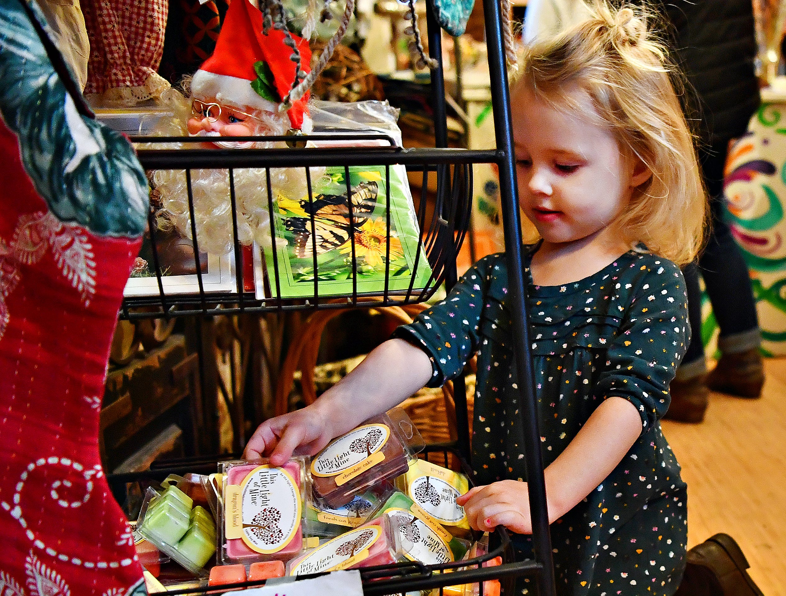 Cora Kozak at her aunt's store, this little light of mine, during Small Business Saturday at Central Market in York City, Saturday, Nov. 24, 2018. Dawn J. Sagert photo