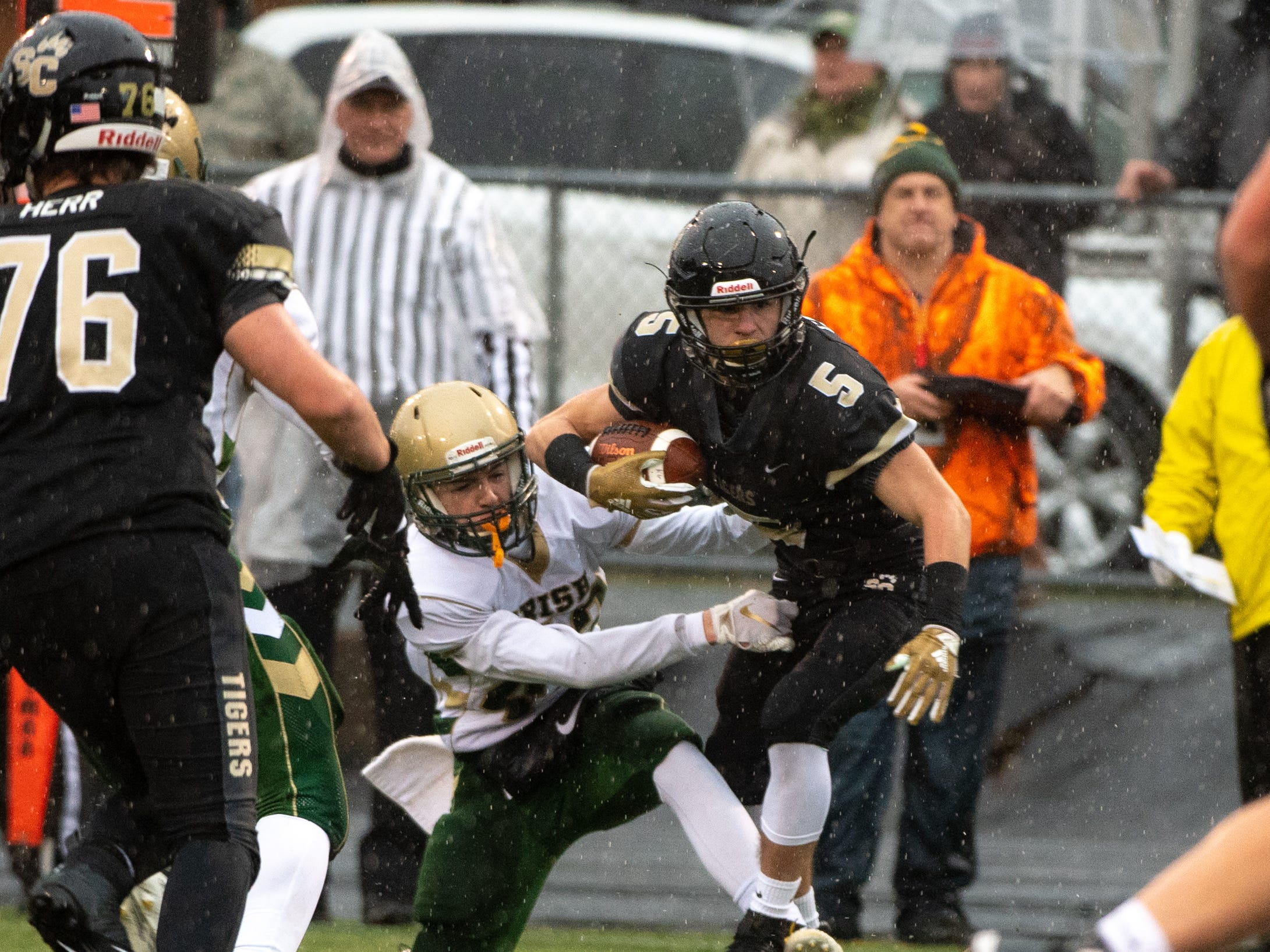 Gavin Garcia (5) evades a tackle during the state quarter-finals game between York Catholic and Southern Columbia, November 24, 2018. The Tigers defeated the Irish 56-23.