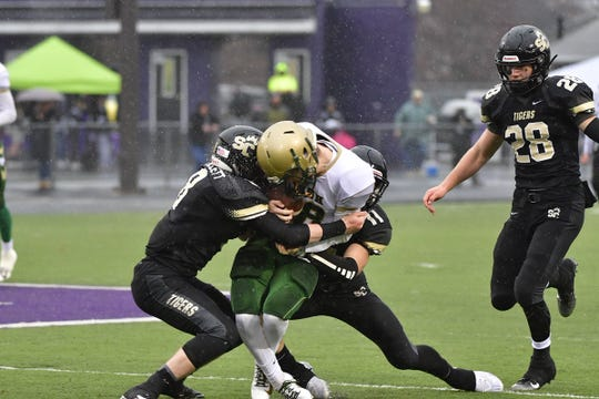 York Catholic's Wes Burns get tackled by Southern Columbia defenders during Saturday's 56-23 state-playoff loss.