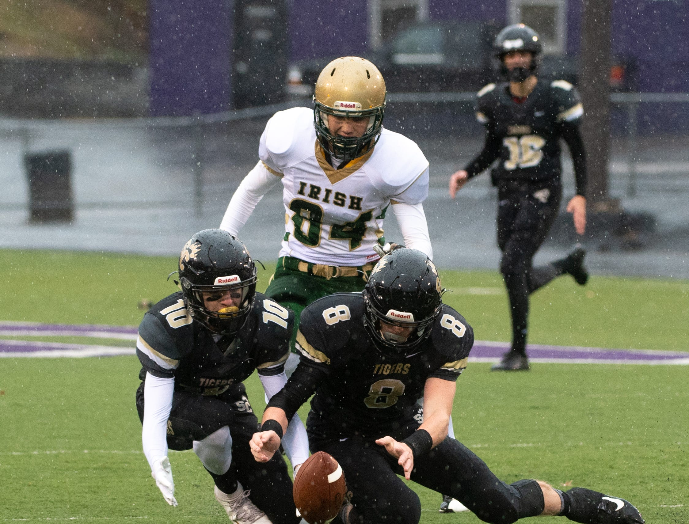 Jacob Davis (10) and Max Tillett (8) look to recover the fumble during the state quarter-finals game between York Catholic and Southern Columbia at Shamokin Area High School, November 24, 2018. The Tigers defeated the Irish 56-23.