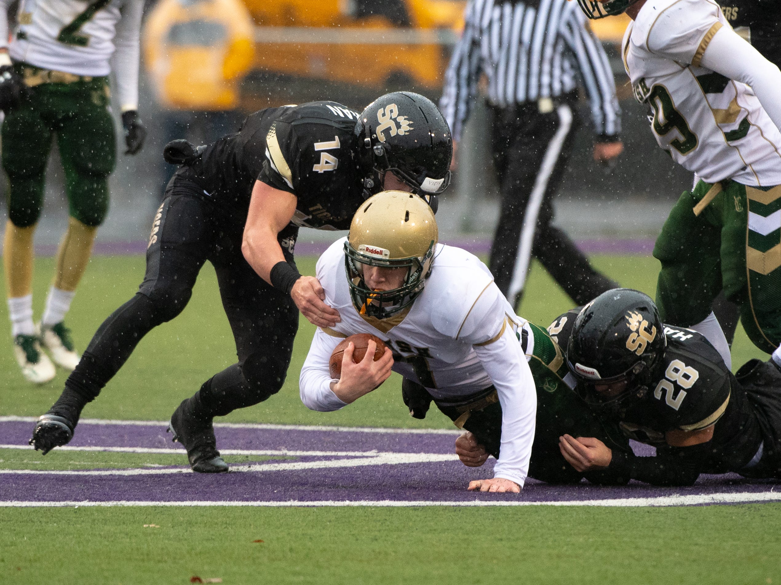Mitchell Galentine (7) tries to get every yard he can during the state quarter-finals game between York Catholic and Southern Columbia at Shamokin Area High School, November 24, 2018. The Tigers defeated the Irish 56-23.