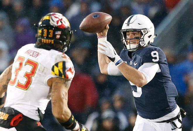 Penn State quarterback Trace McSorley (9) looks to pass as Maryland's Tre Watson (33) applies the pressure during the first half of an NCAA college football game in State College, Pa., Saturday, Nov. 24, 2018.