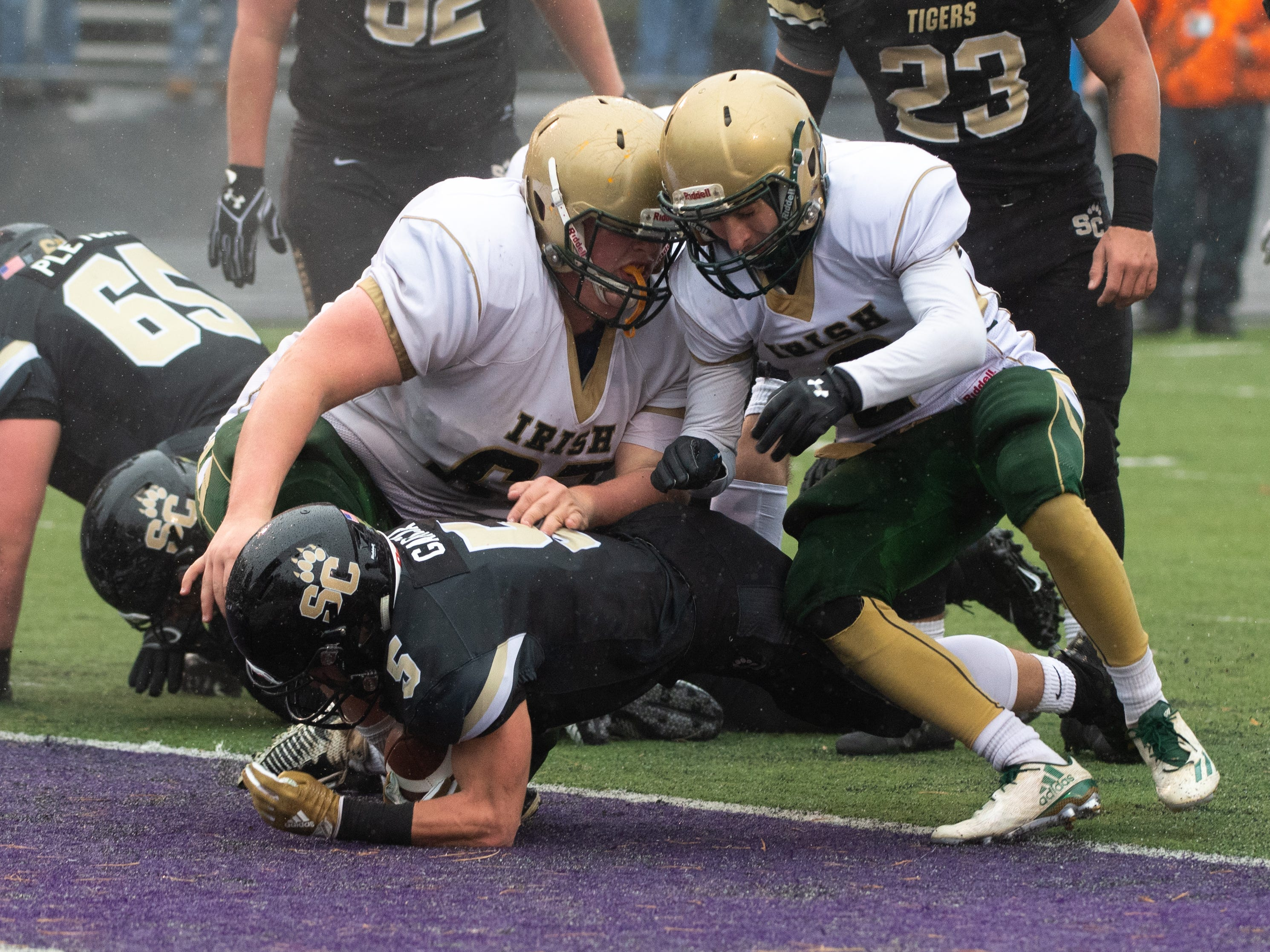 Gavin Garcia (5) stretches into the end zone during the state quarter-finals game between York Catholic and Southern Columbia at Shamokin Area High School, November 24, 2018. The Tigers defeated the Irish 56-23.