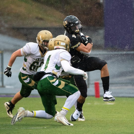 Southern Columbia's Julian Fleming (4) breaks tackles during the state quarter-finals game between York Catholic and Southern Columbia at Shamokin Area High School, November 24, 2018. The Tigers defeated the Irish 56-23.